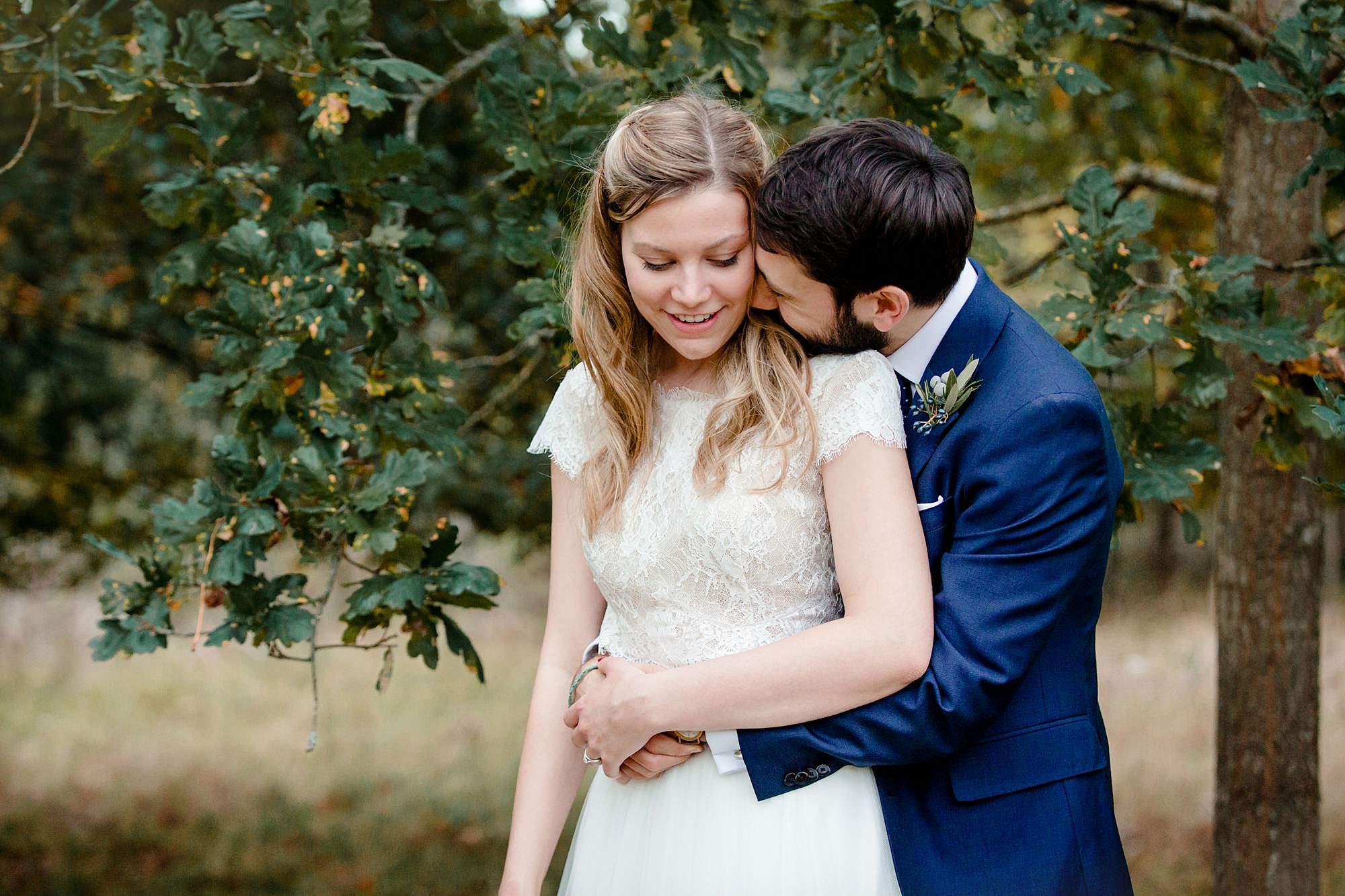 shaw house wedding bride and groom hug together