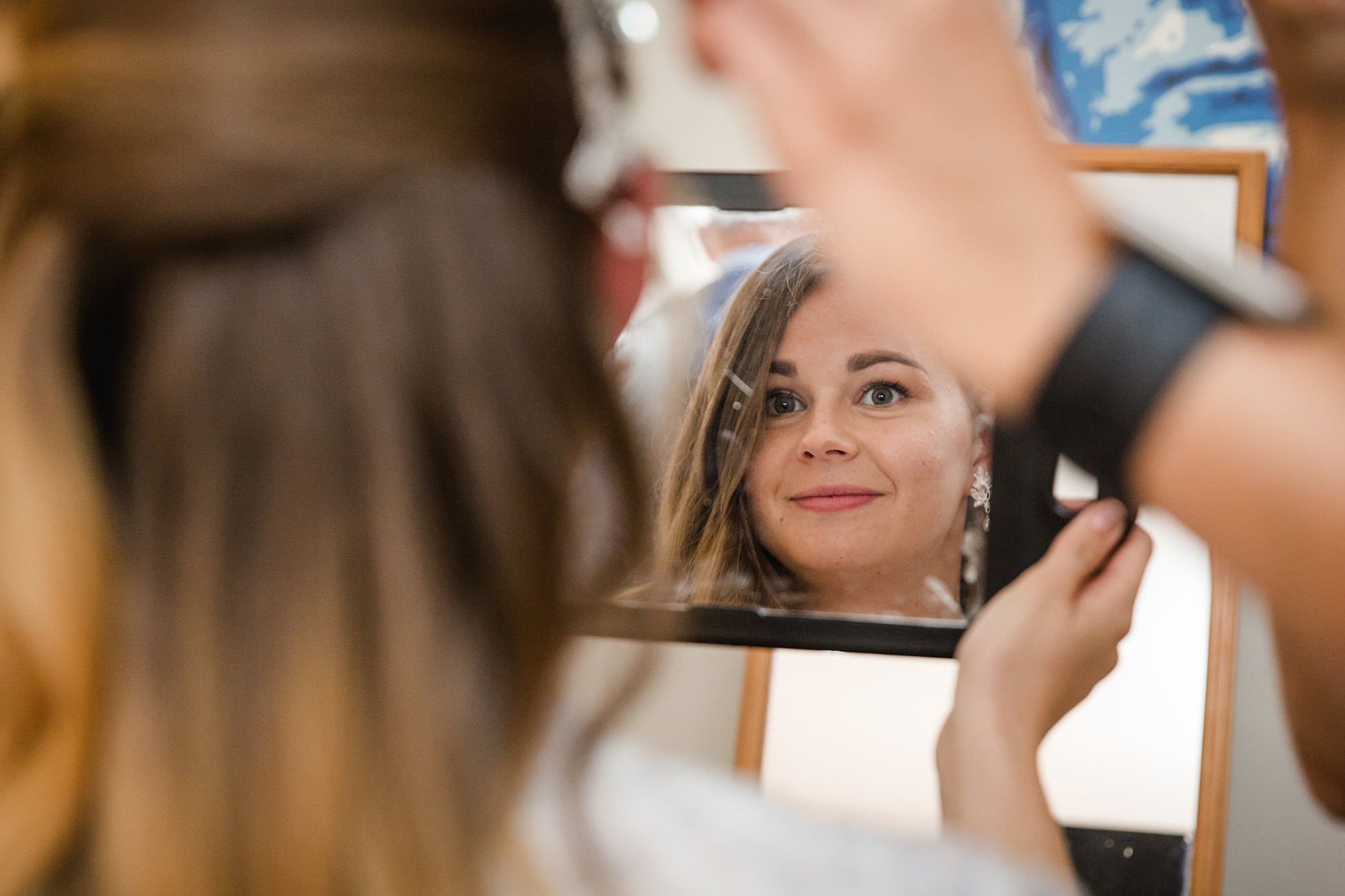 Writtle university college wedding bride looks in the mirror