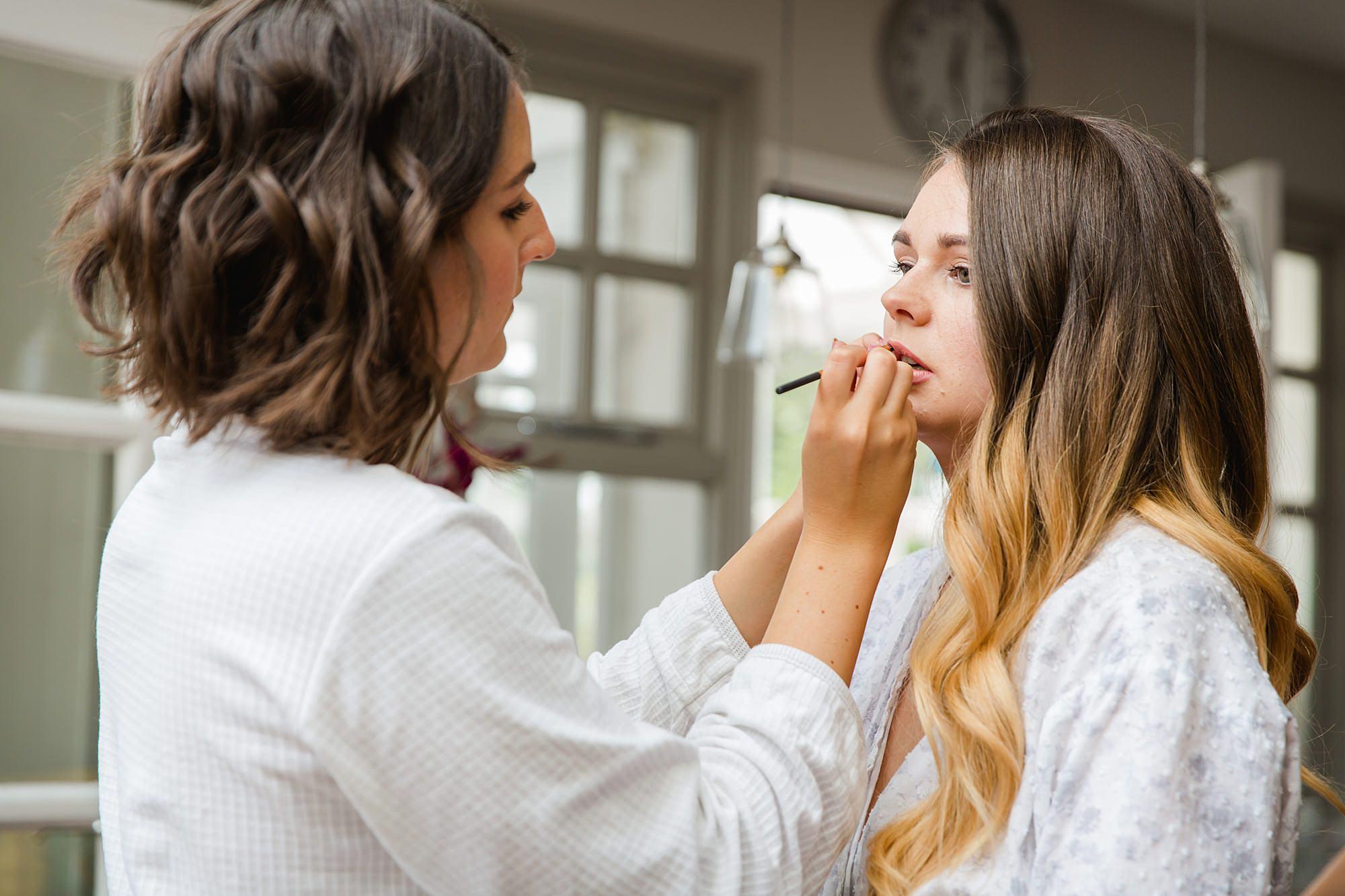 Writtle university college wedding bride having her lipstick applied