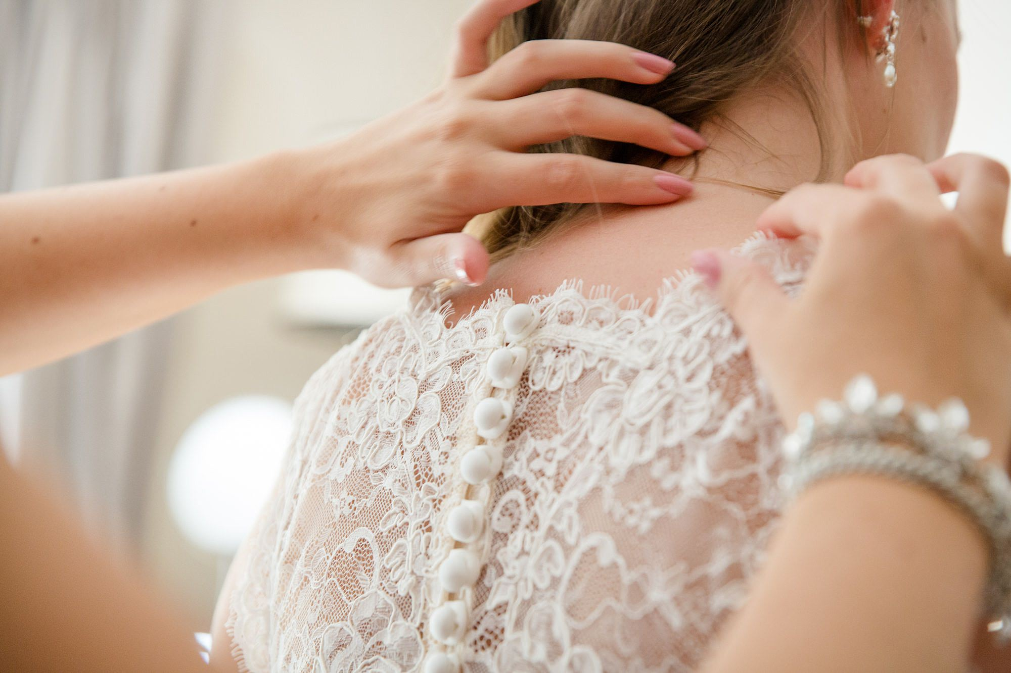 Writtle university college wedding final touches to wedding dress