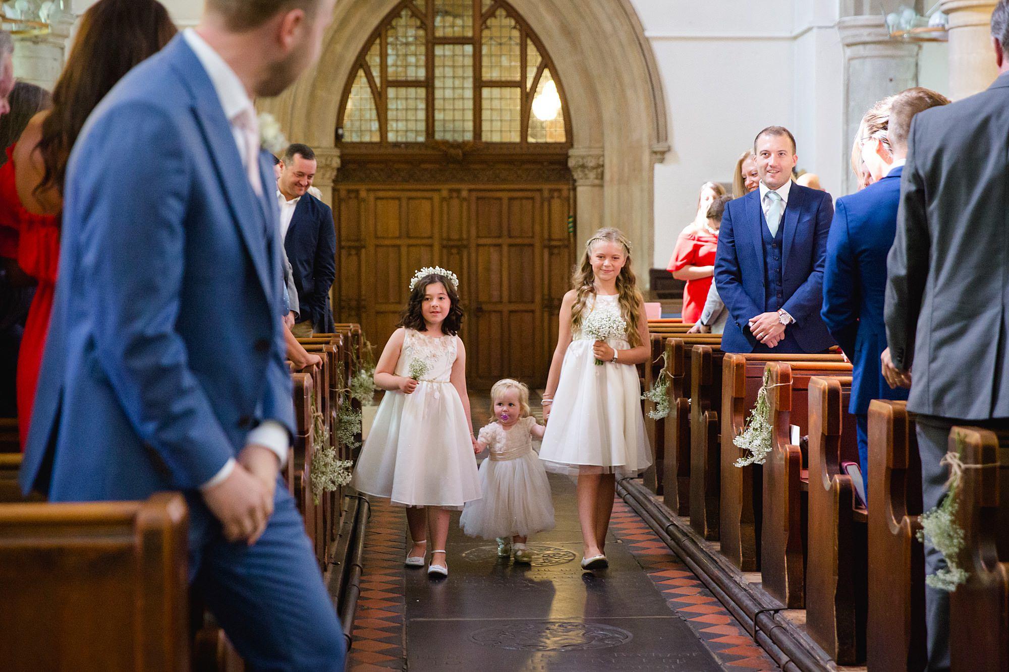 Writtle university college wedding flower girls walk down aisle