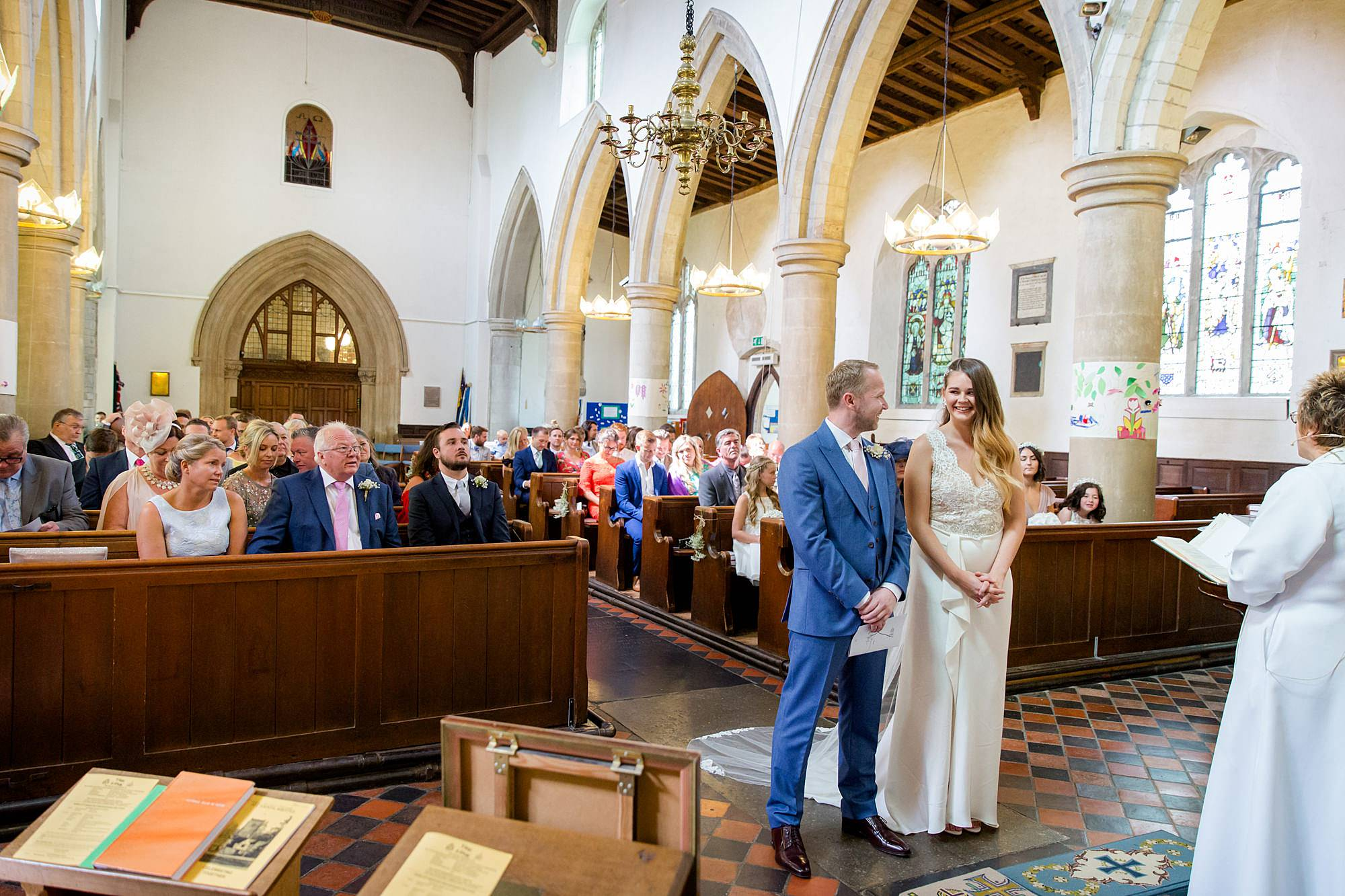 Writtle university college wedding bride and groom laugh together