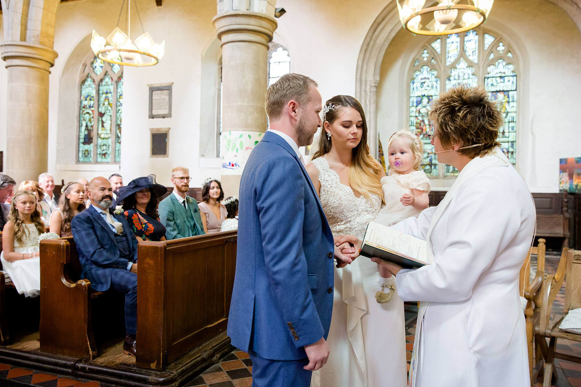 Writtle university college wedding bride and groom receive blessing