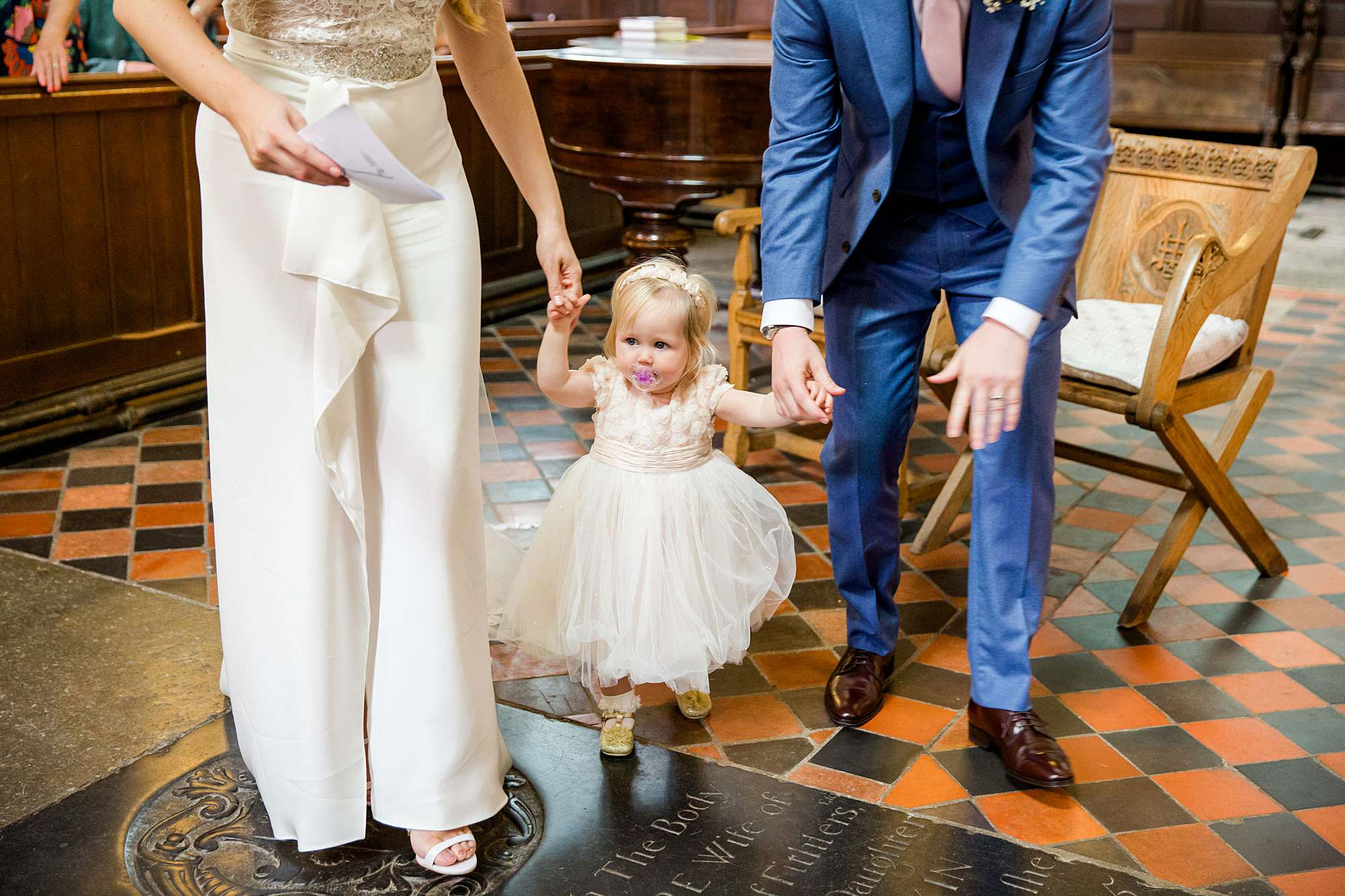 Writtle university college wedding bride and groom walk with flower girl