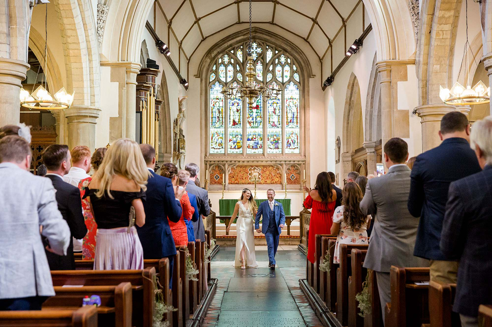 Writtle university college wedding bride and groom walk down aisle