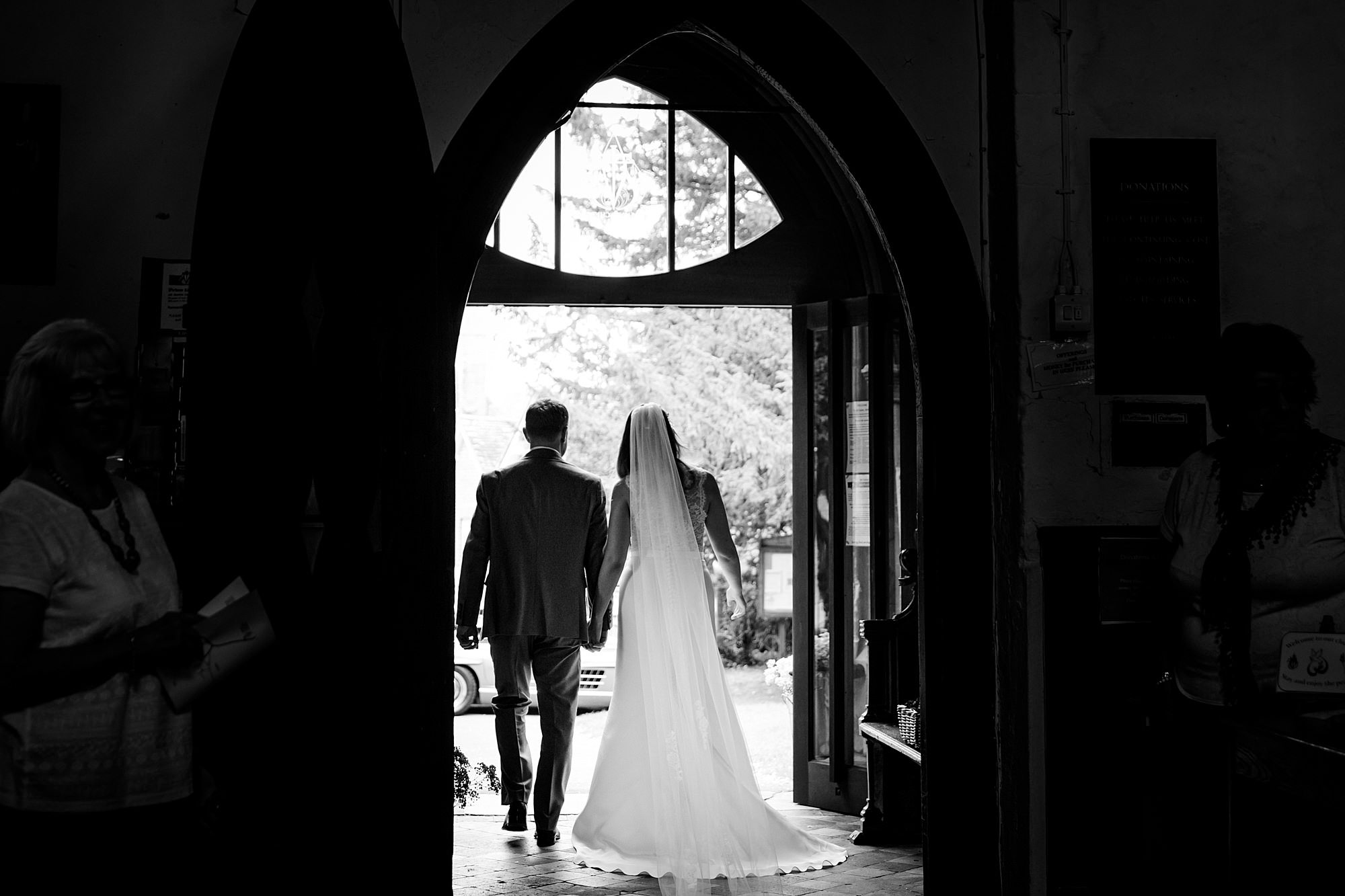 Writtle university college wedding bride and groom exit church door