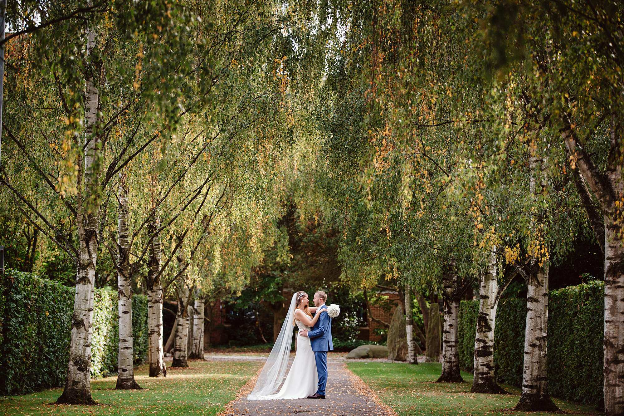 Writtle university college wedding bride and groom in gardens