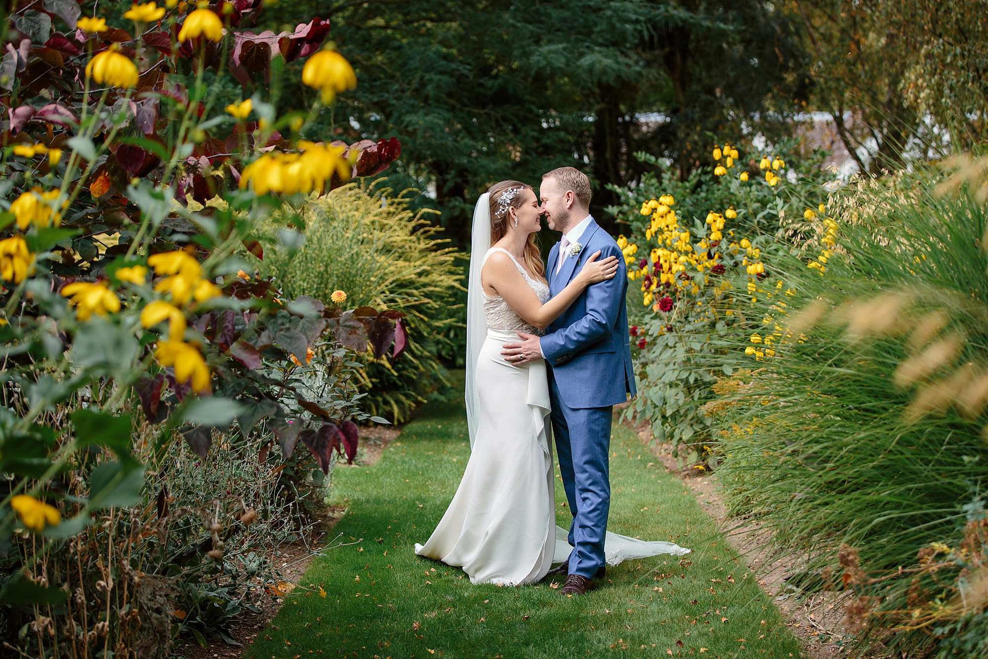 Writtle university college wedding bride and groom amongst flowers