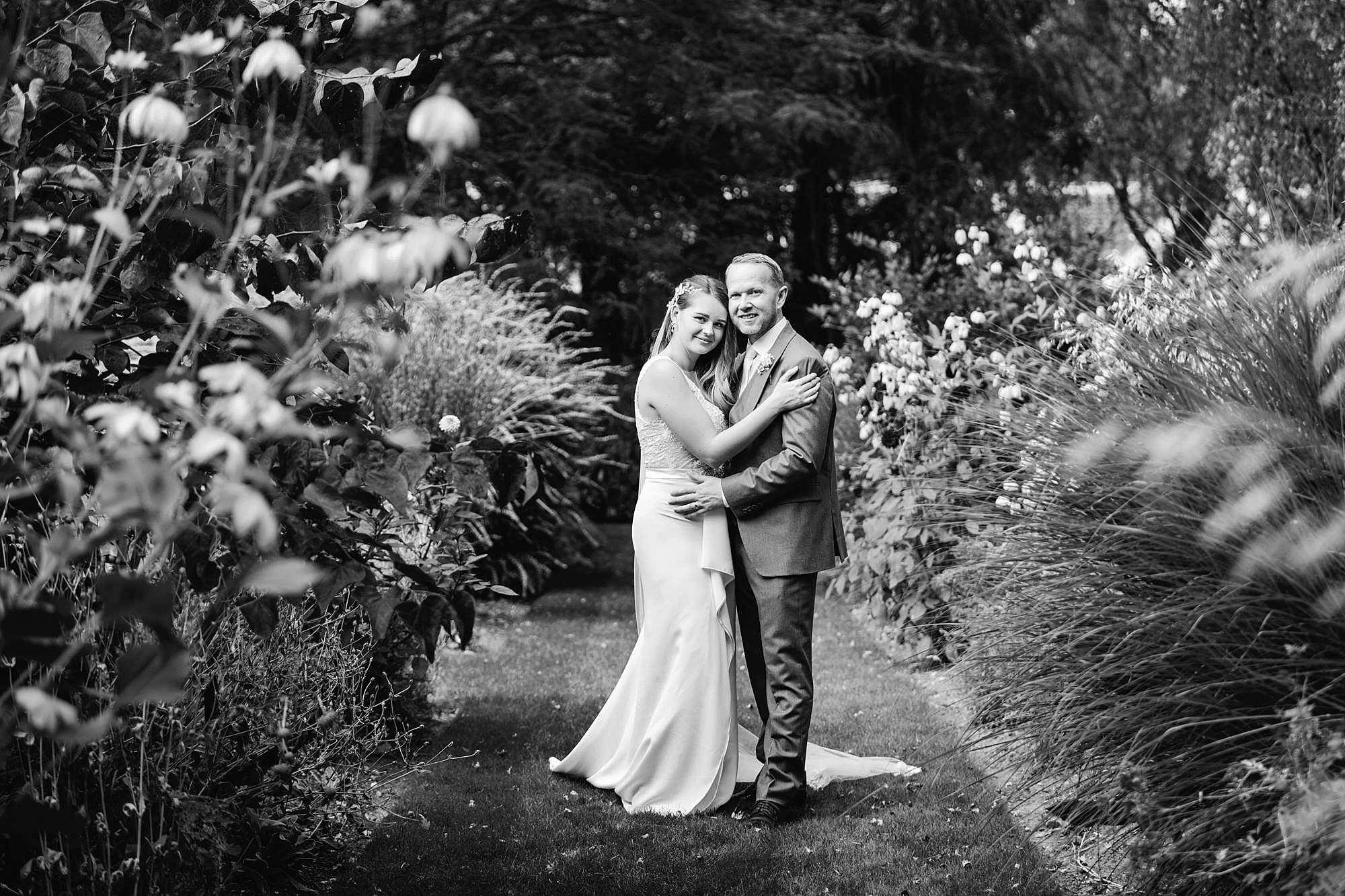 Writtle university college wedding bride and groom in flower garden