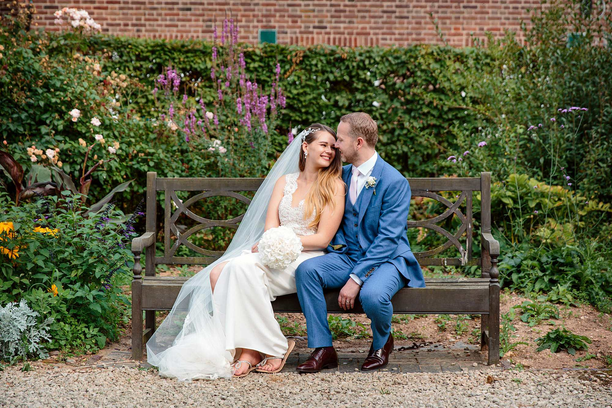 Writtle university college wedding bride and groom on bench