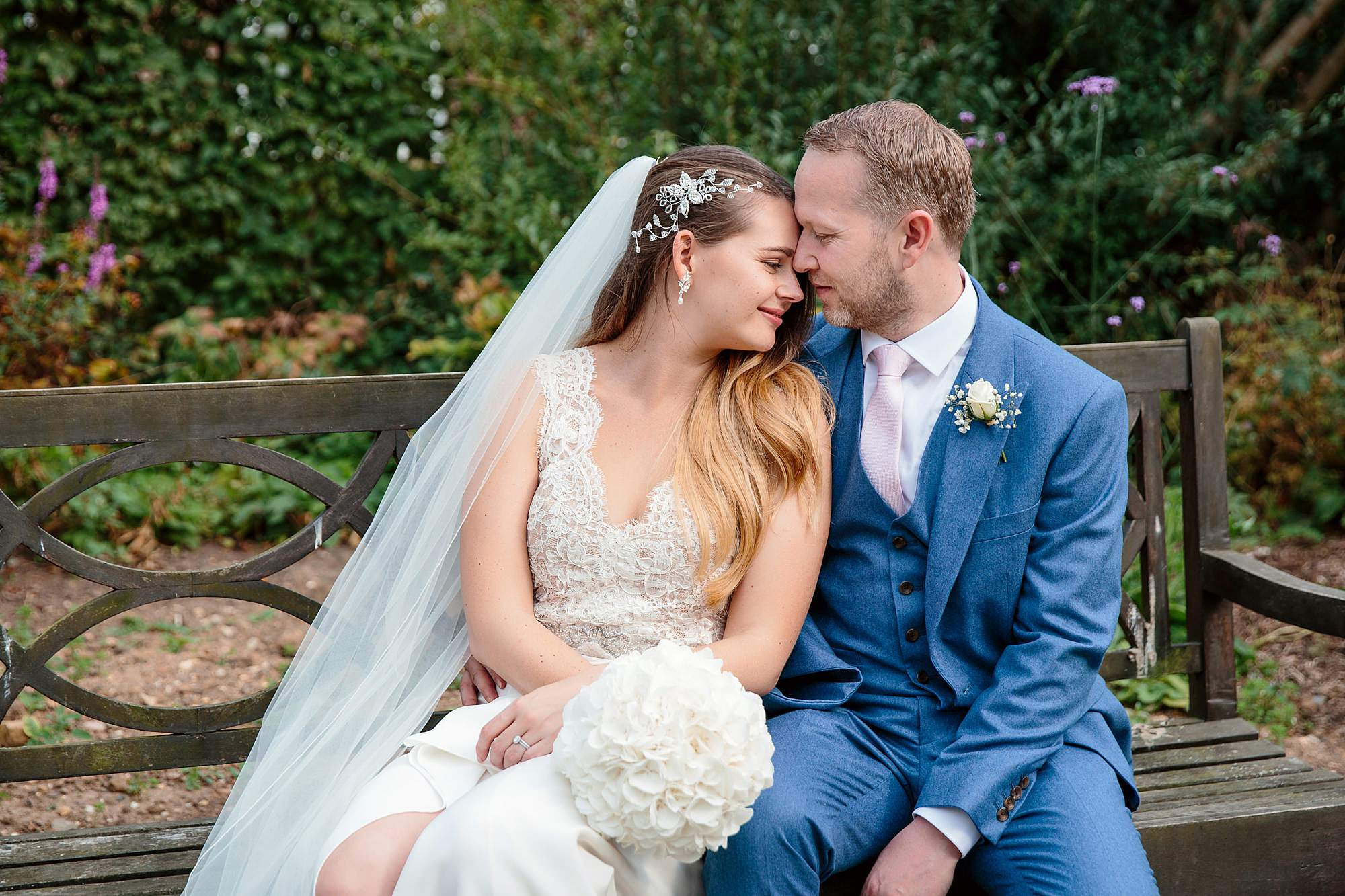 Writtle university college wedding groom and bride on bench