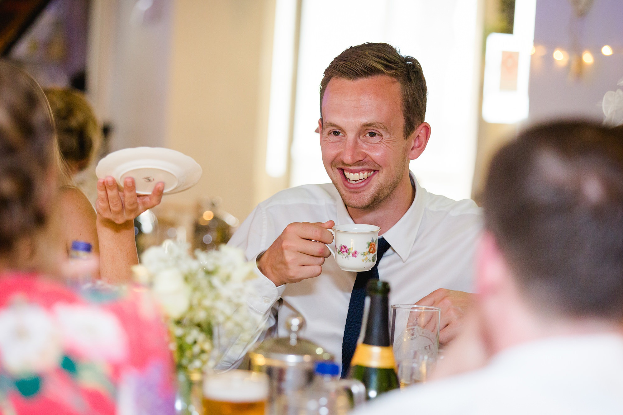 Writtle university college wedding guests laughs over a cup of tea