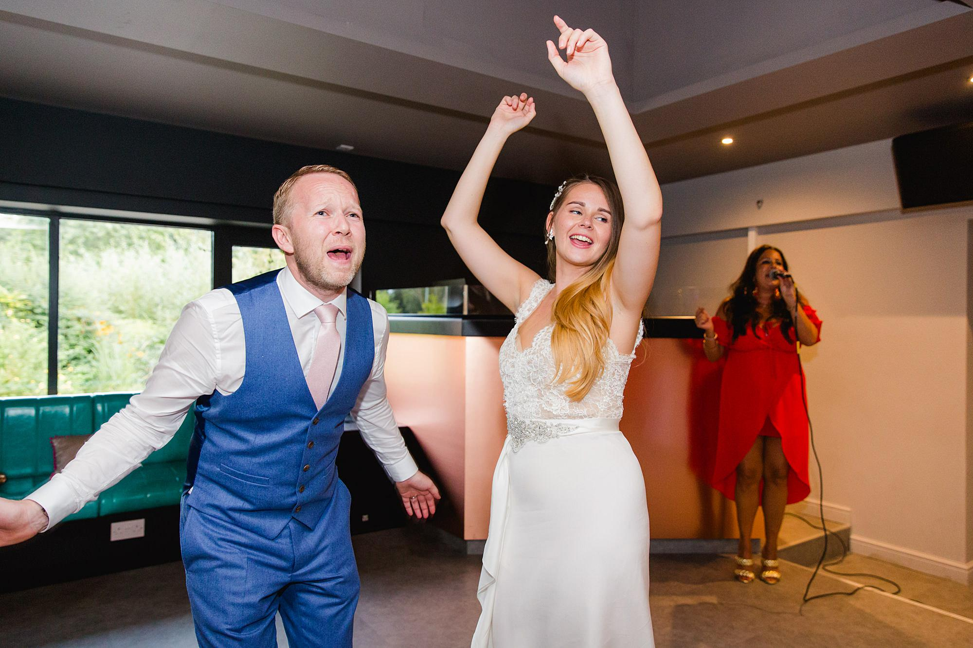 Writtle university college wedding bride and groom dance to fast music