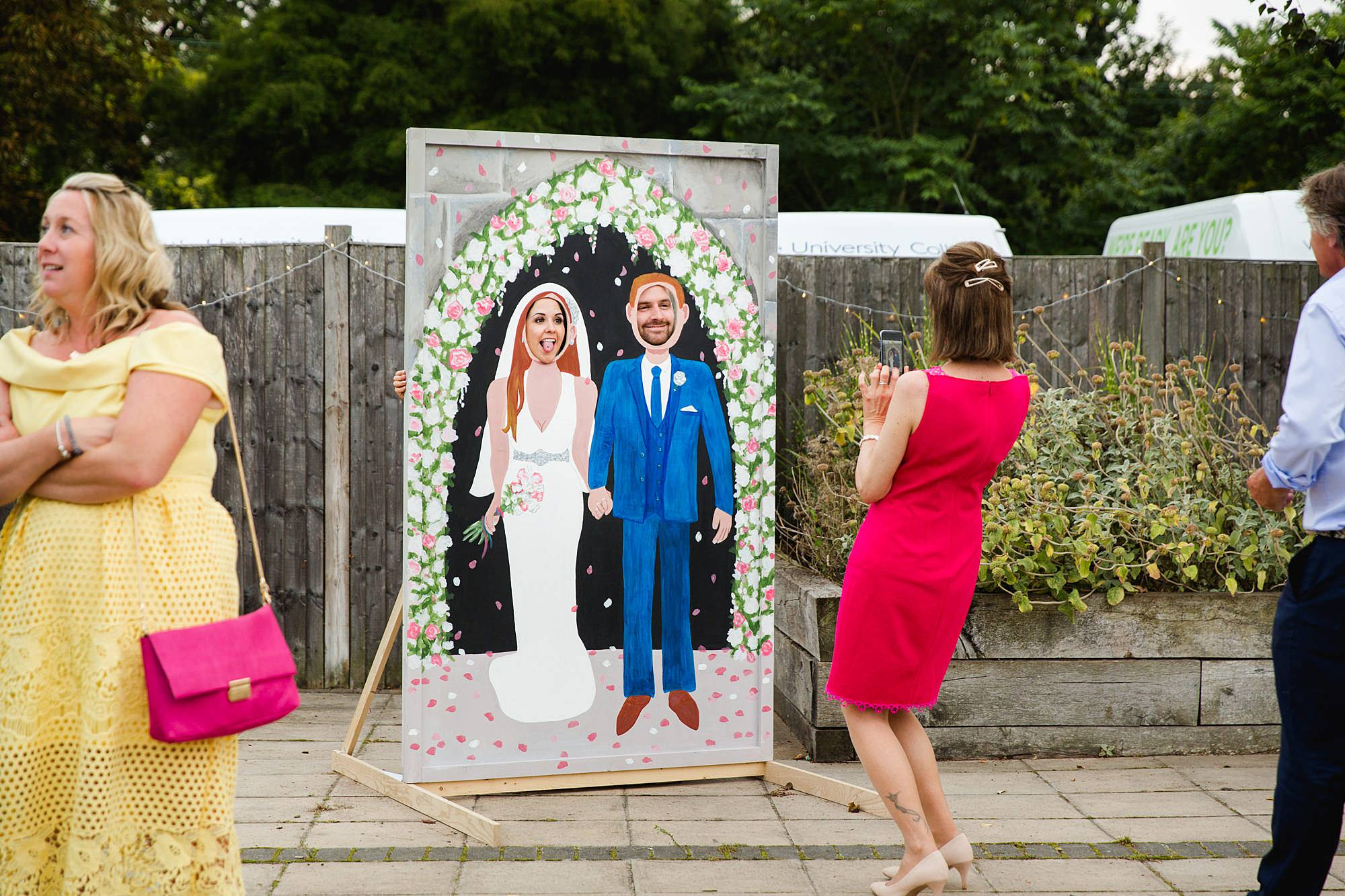 Writtle university college wedding guests enjoying face in hole board