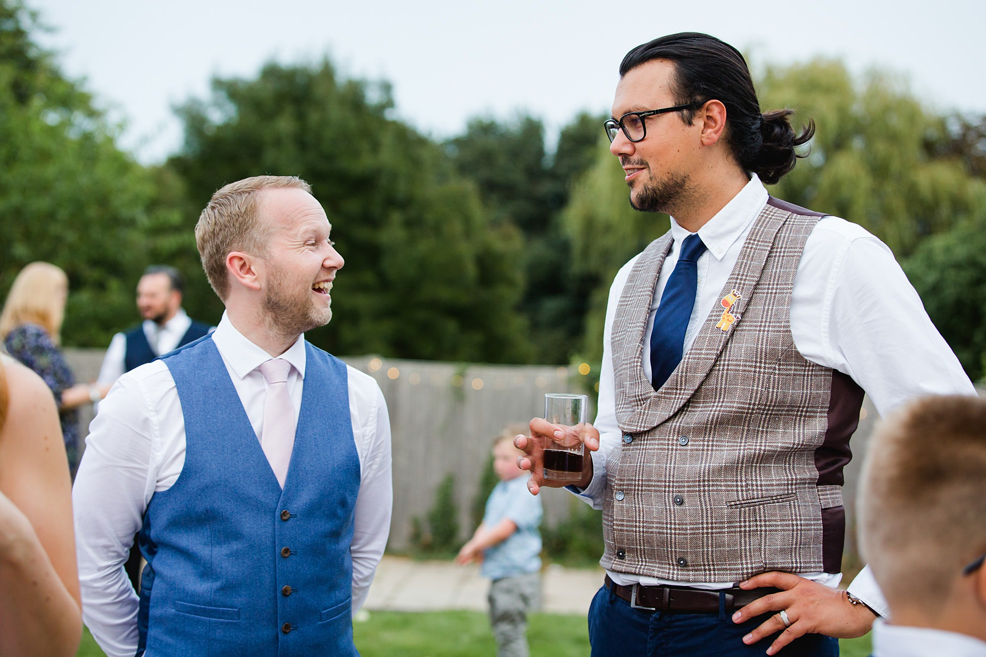 Writtle university college wedding groom chats to guest