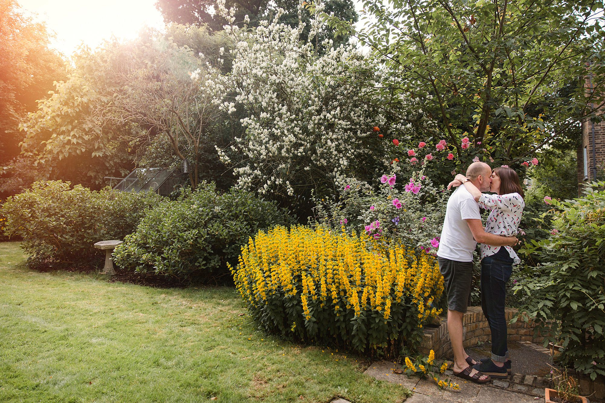engagement shoot with cat couple in their garden