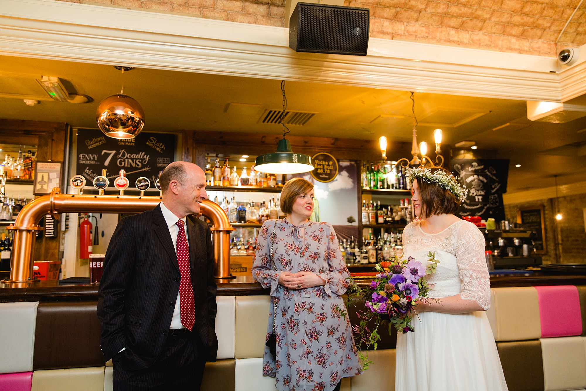 fun london wedding bowling bride chats with guests