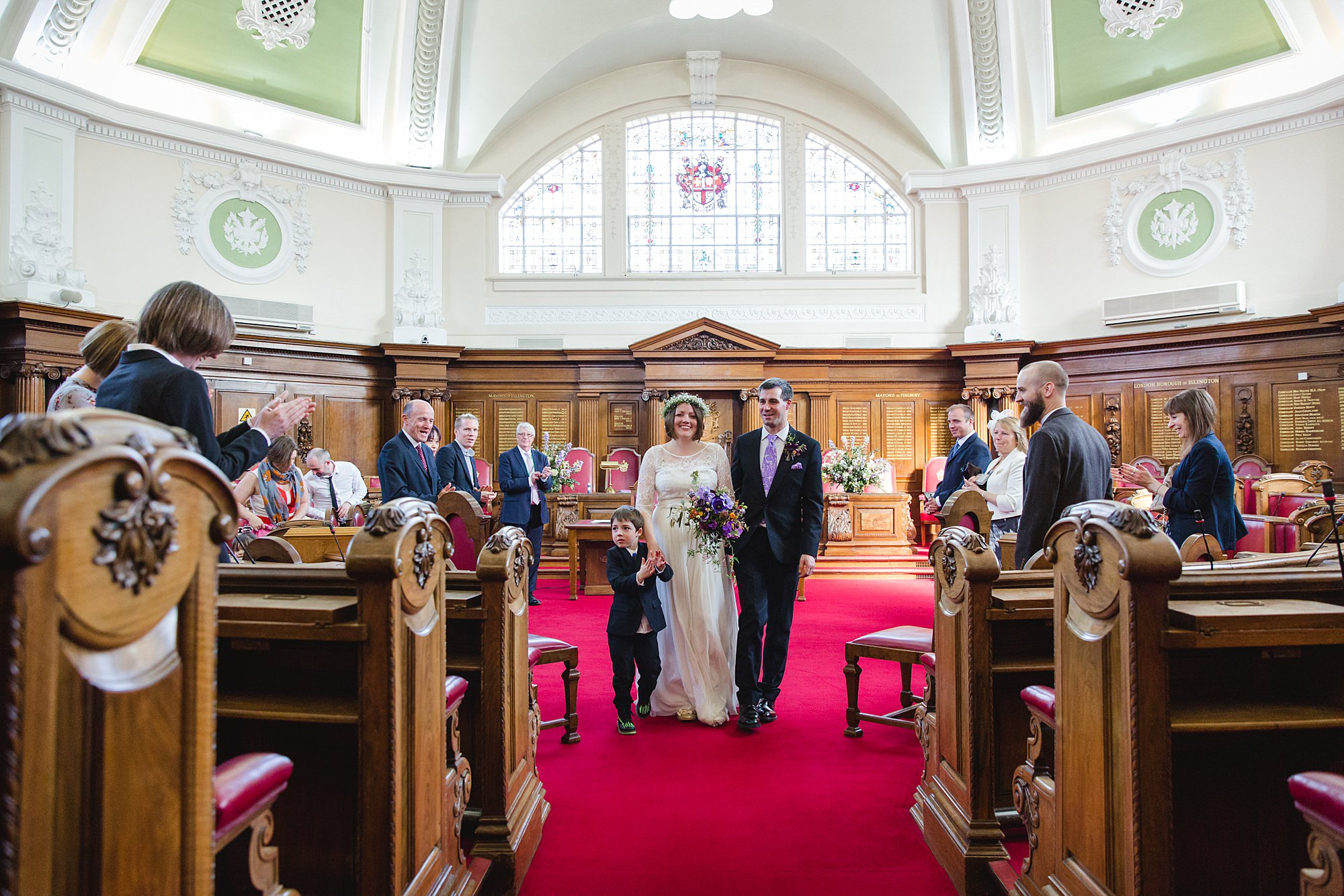 fun london wedding bowling bride and groom walk down aisle