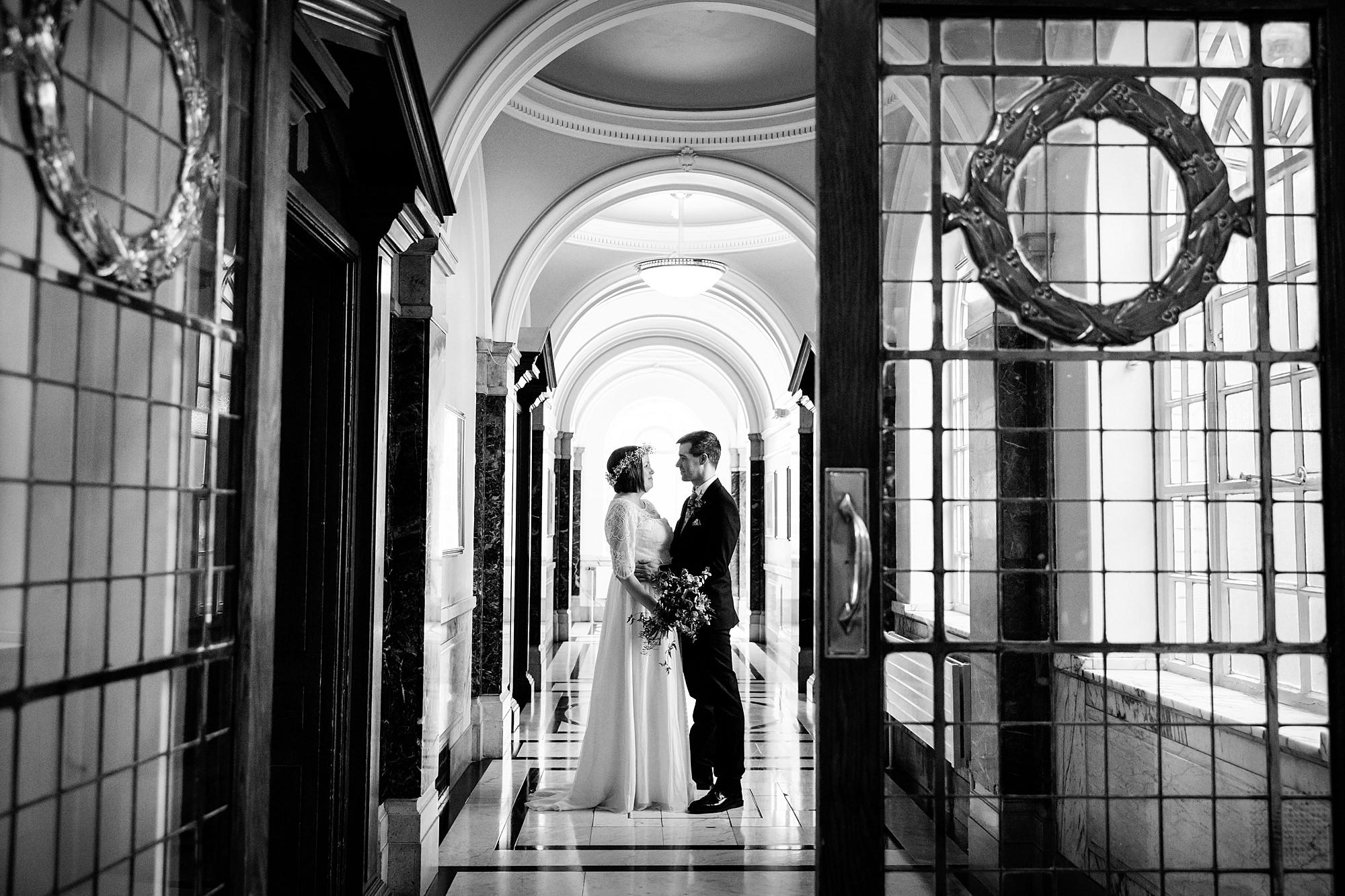 fun london wedding bowling bride and groom in hallway