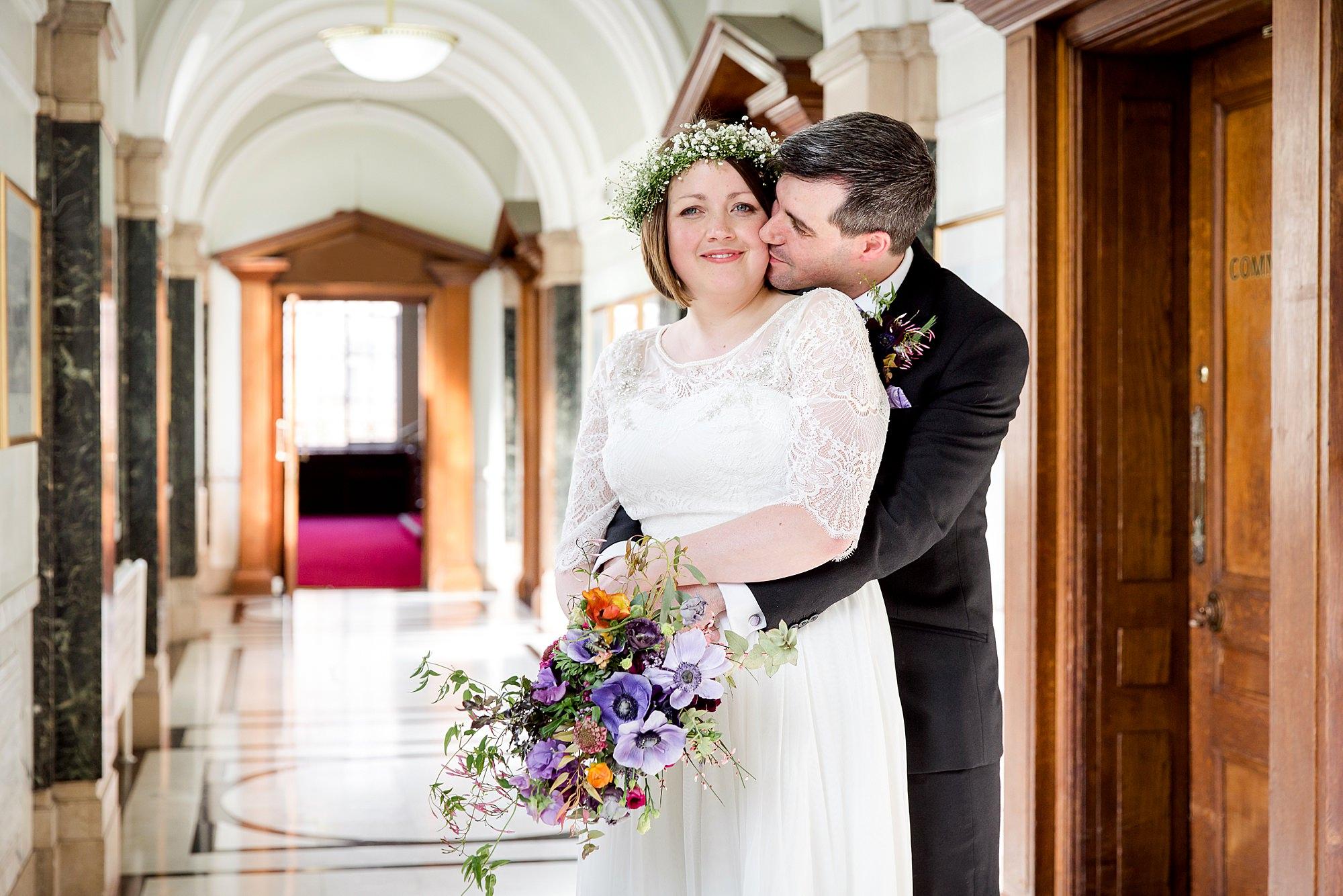 fun london wedding bowling groom hugs bride