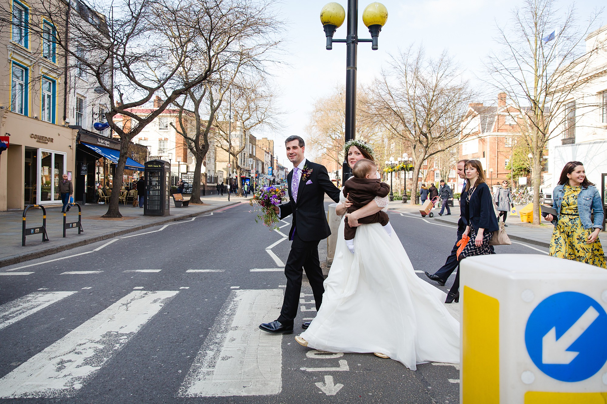 fun london wedding bowling bride and groom walking over crossing