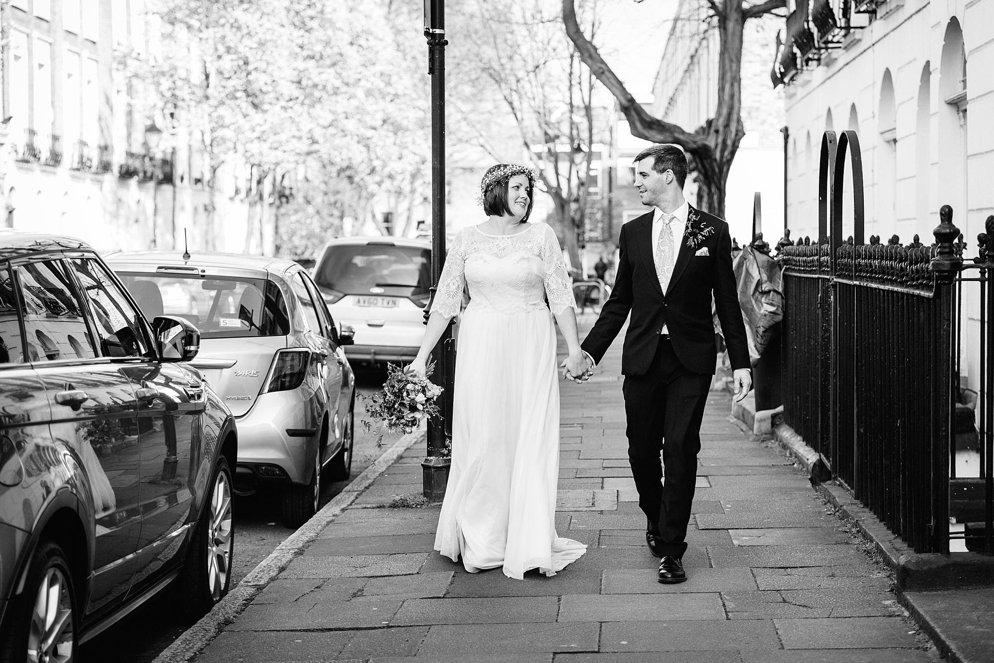 fun london wedding bowling bride and groom walking in street