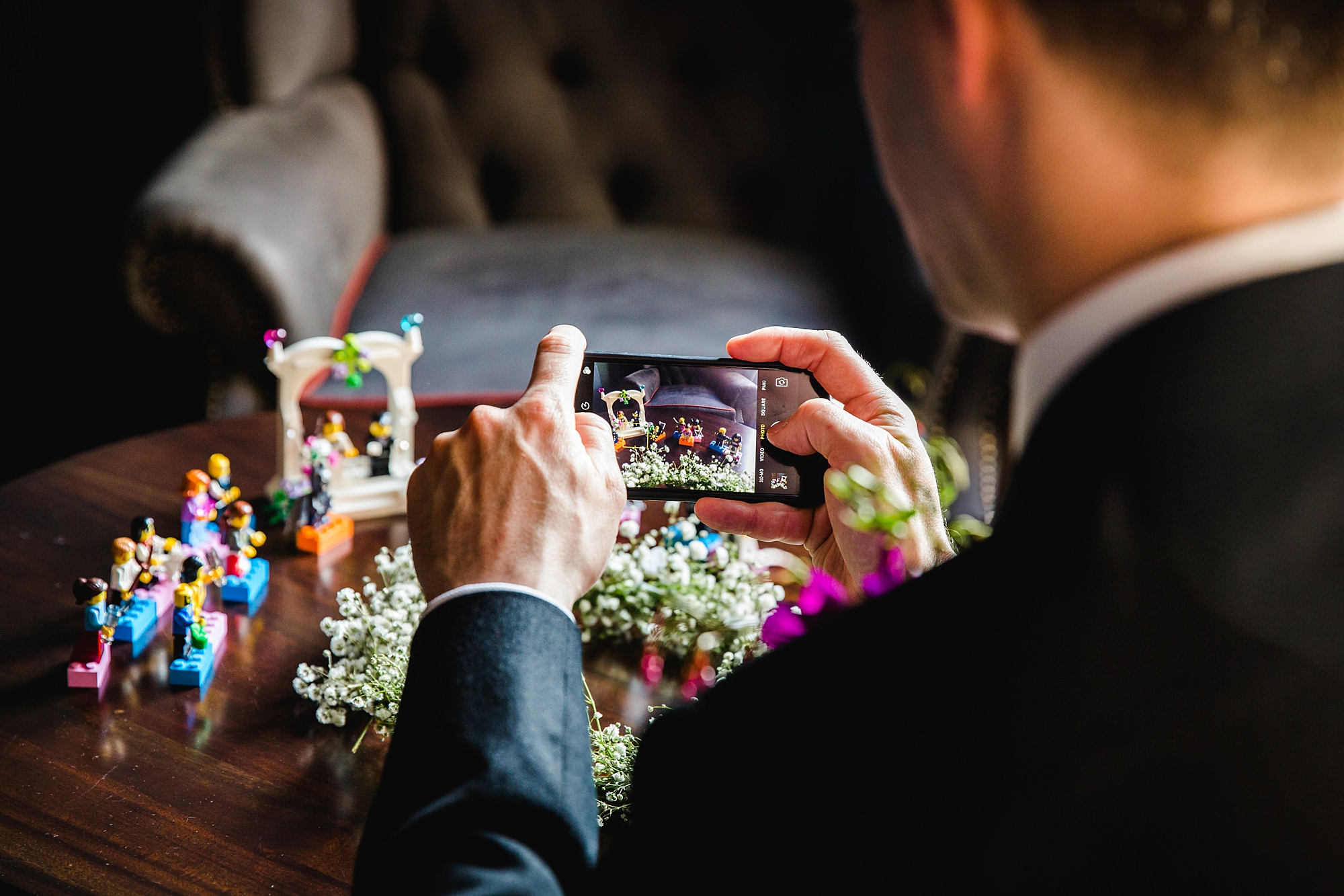 fun london wedding bowling guest takes picture of decoration