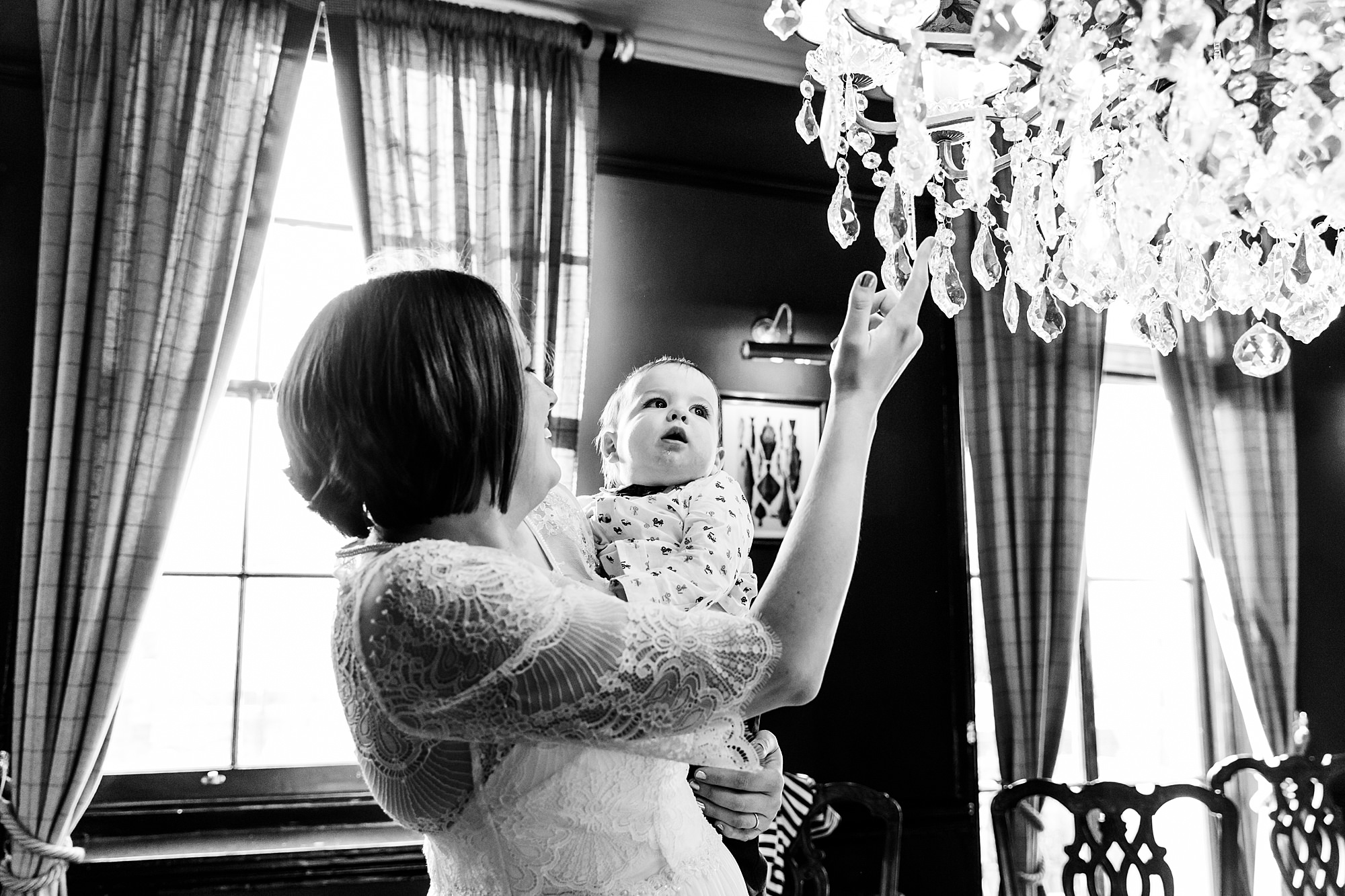 fun london wedding bowling little guest plays with chandelier