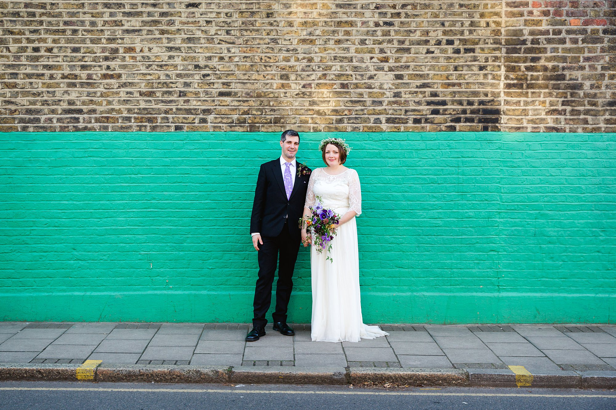 fun london wedding bowling bride and groom by funky wall