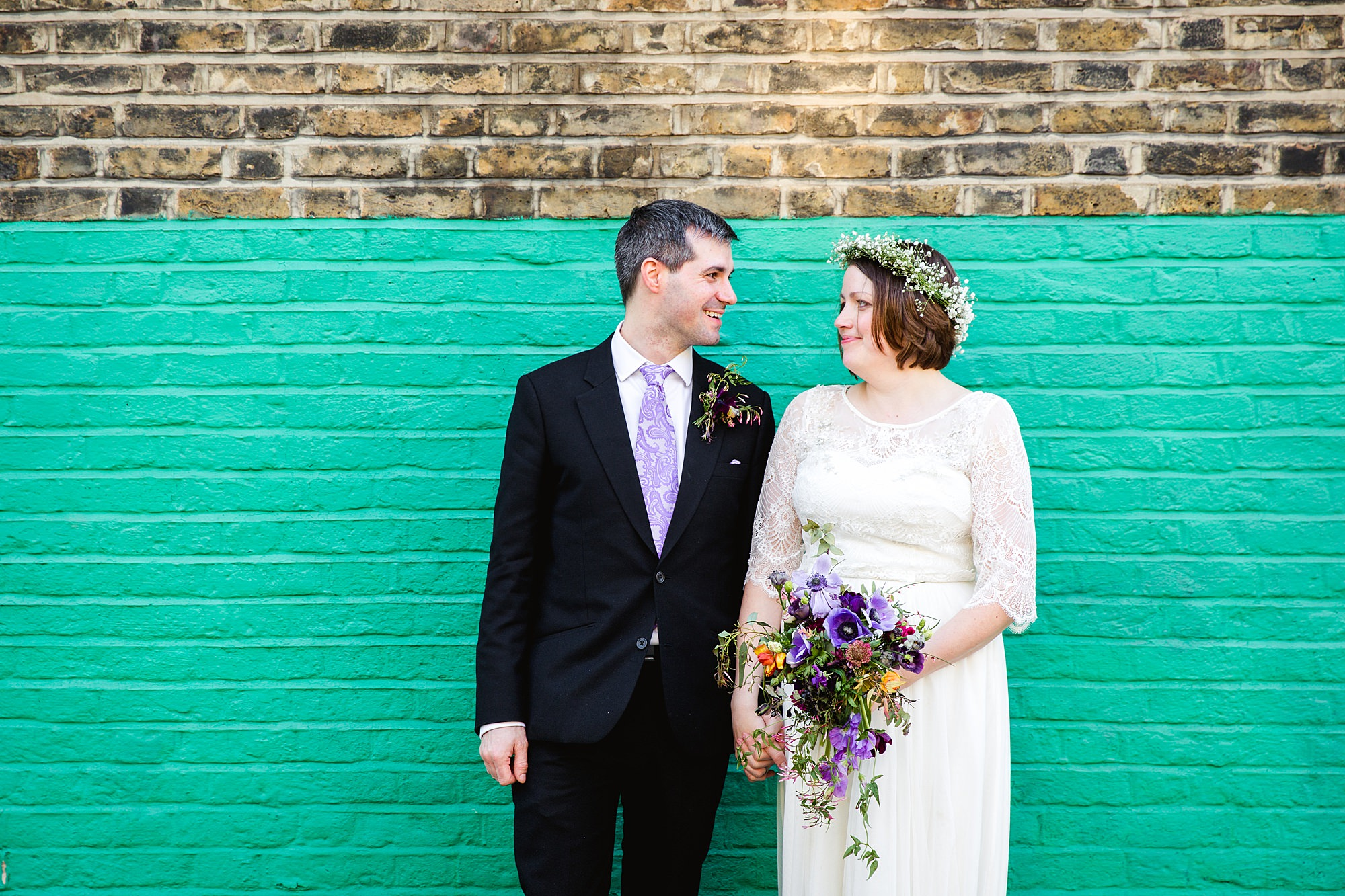 fun london wedding bowling couple laugh together by fun wall