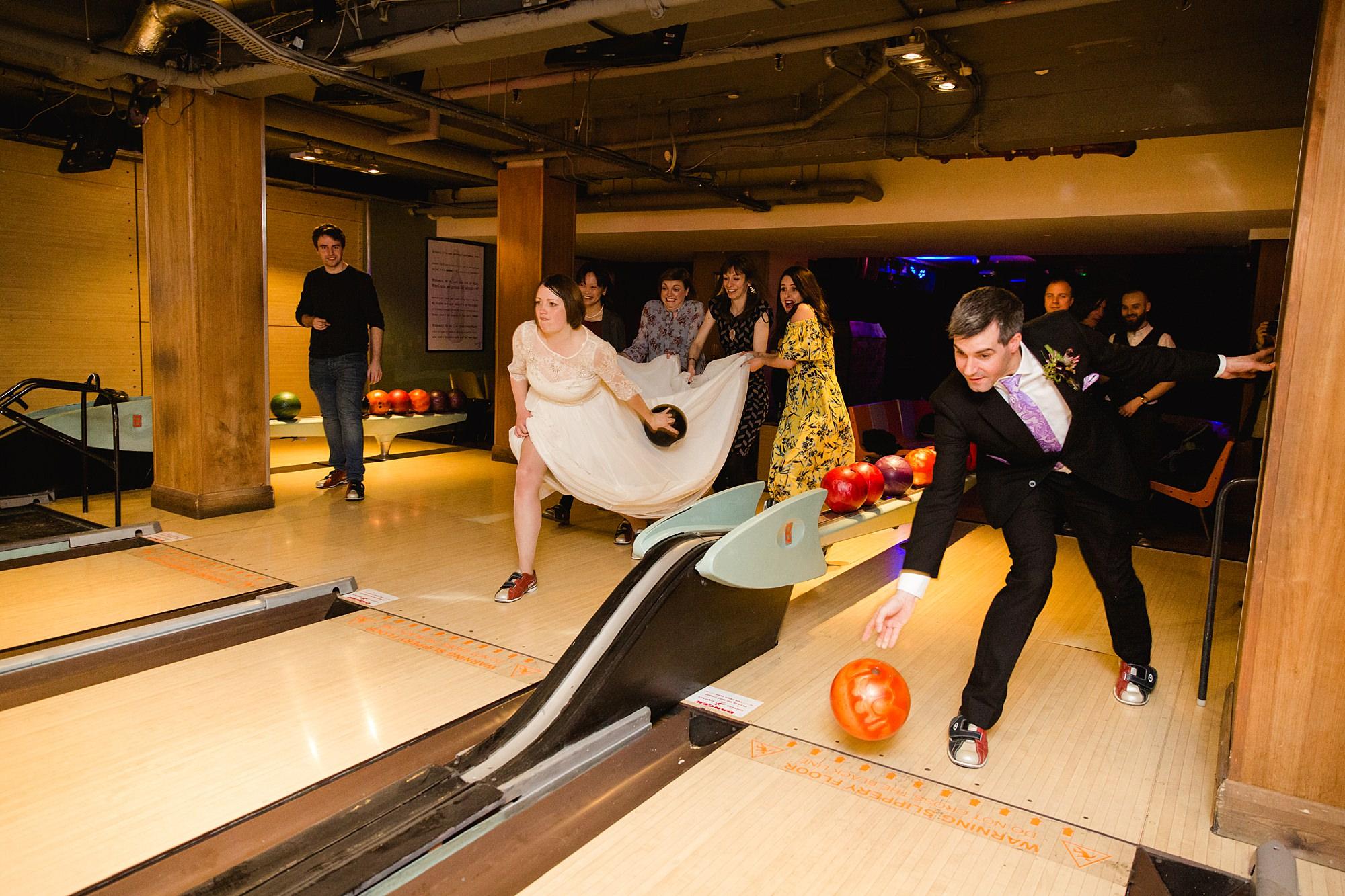 fun london wedding bowling bride and groom bowl