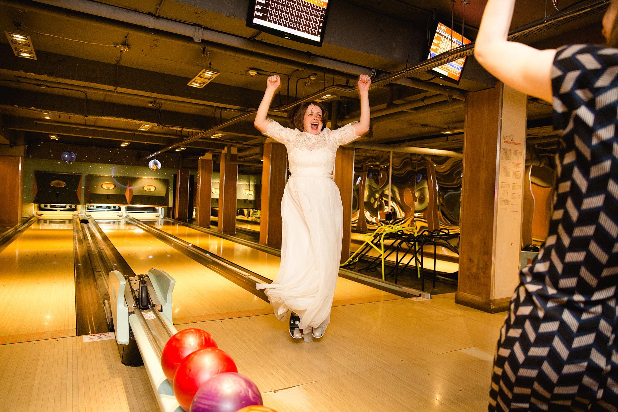 fun london wedding bowling bride cheers