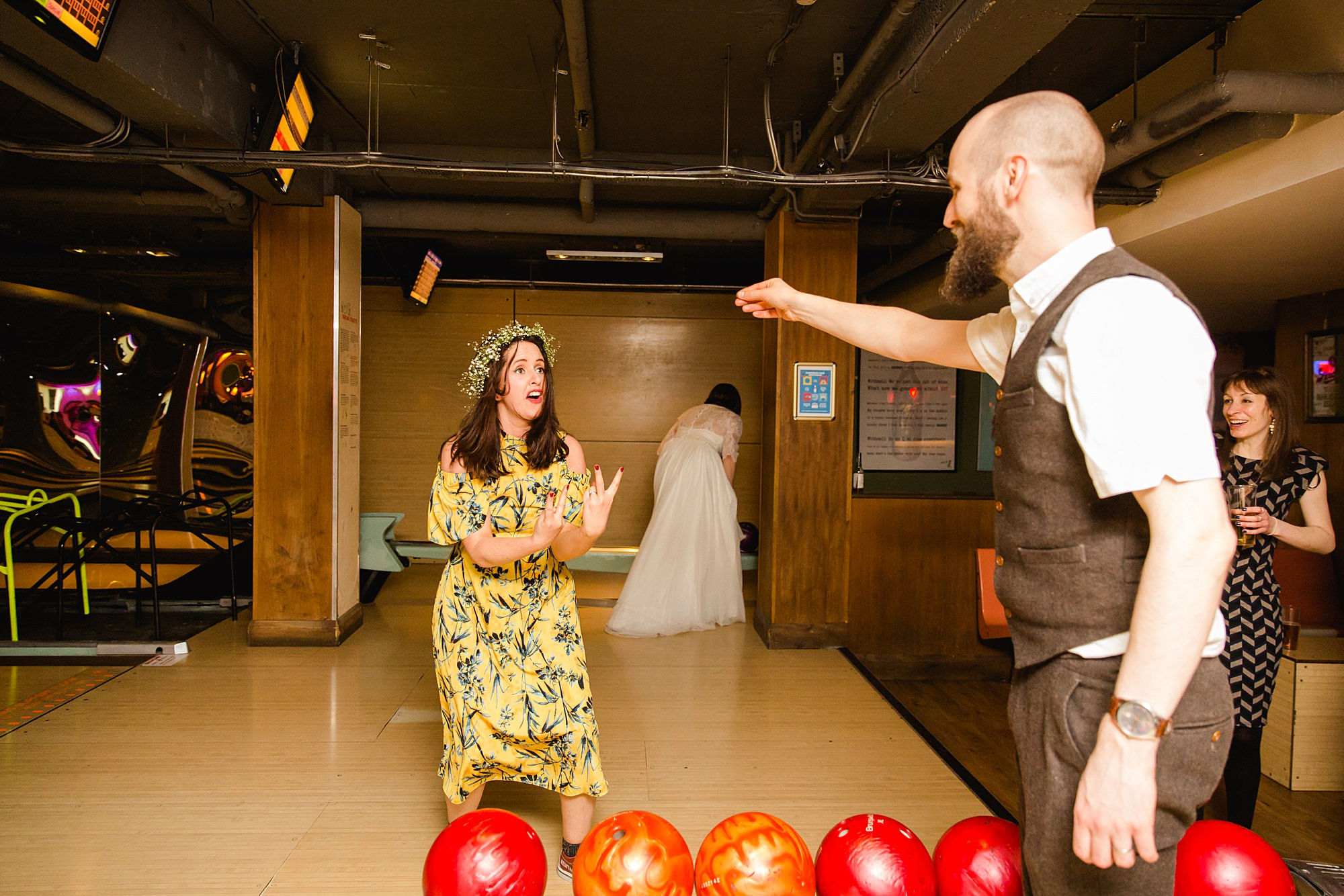fun london wedding bowling guests cheer during bowling