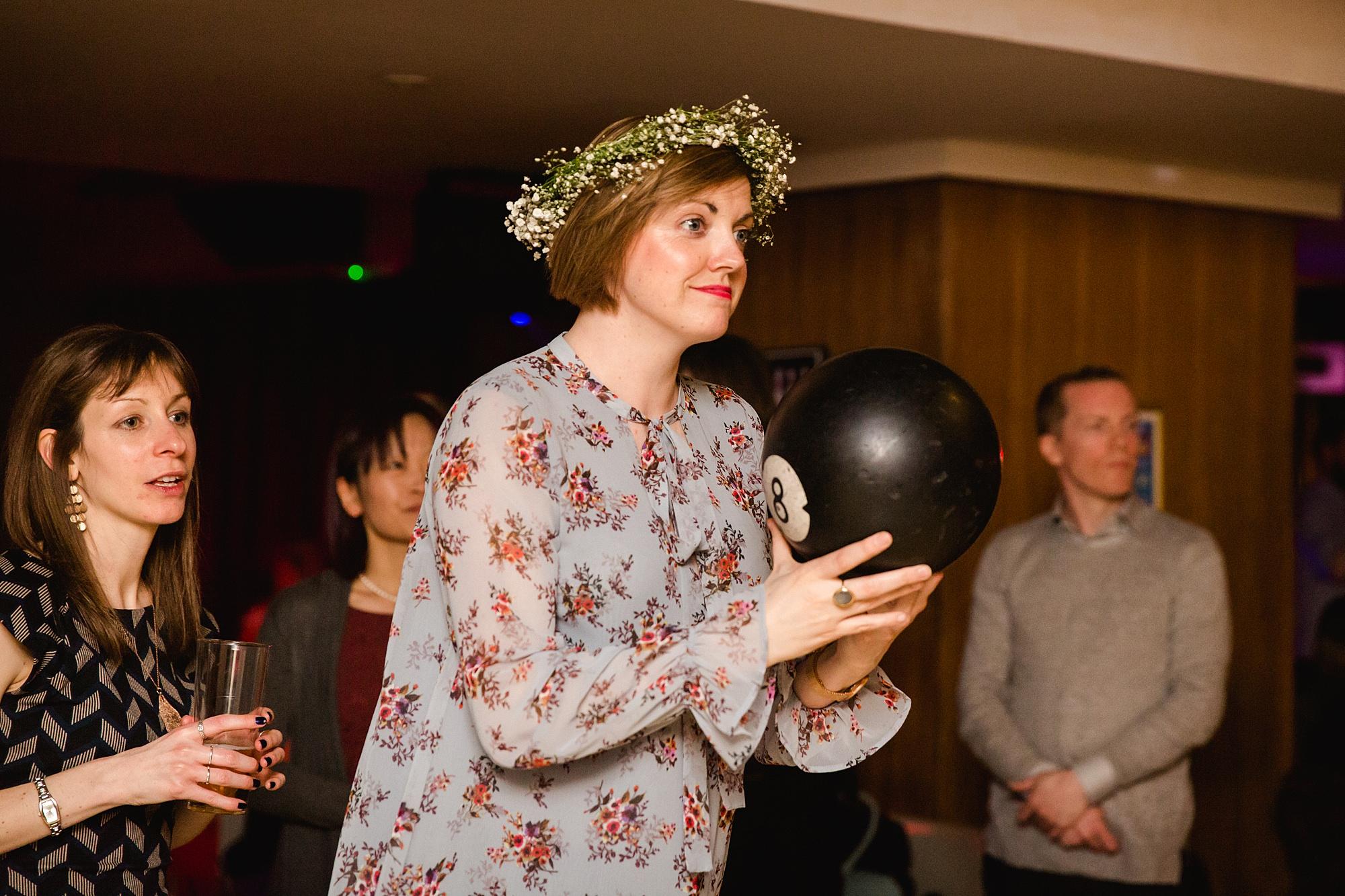 fun london wedding bowling guest prepares to bowl