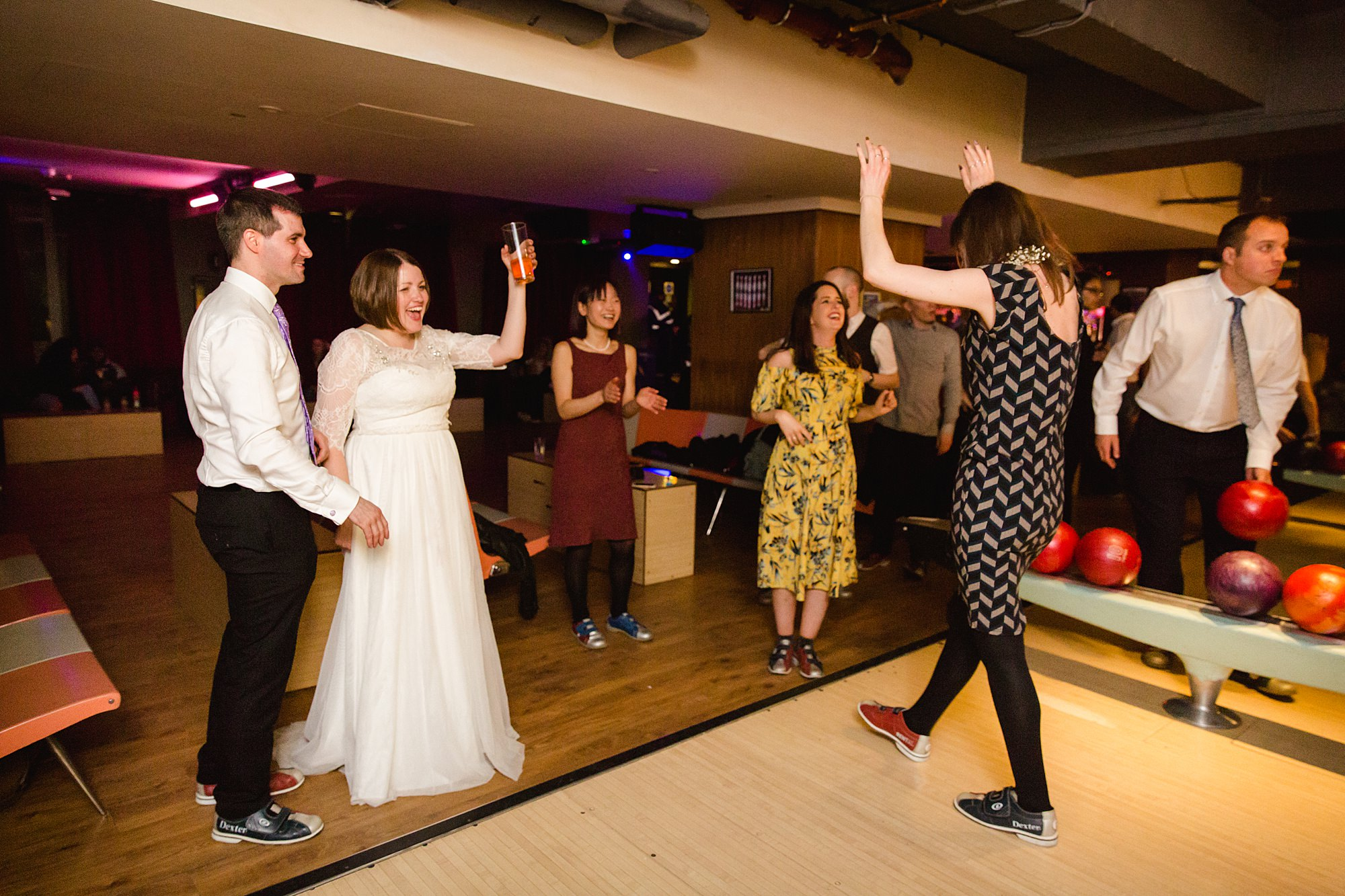 fun london wedding bowling guest celebrates win