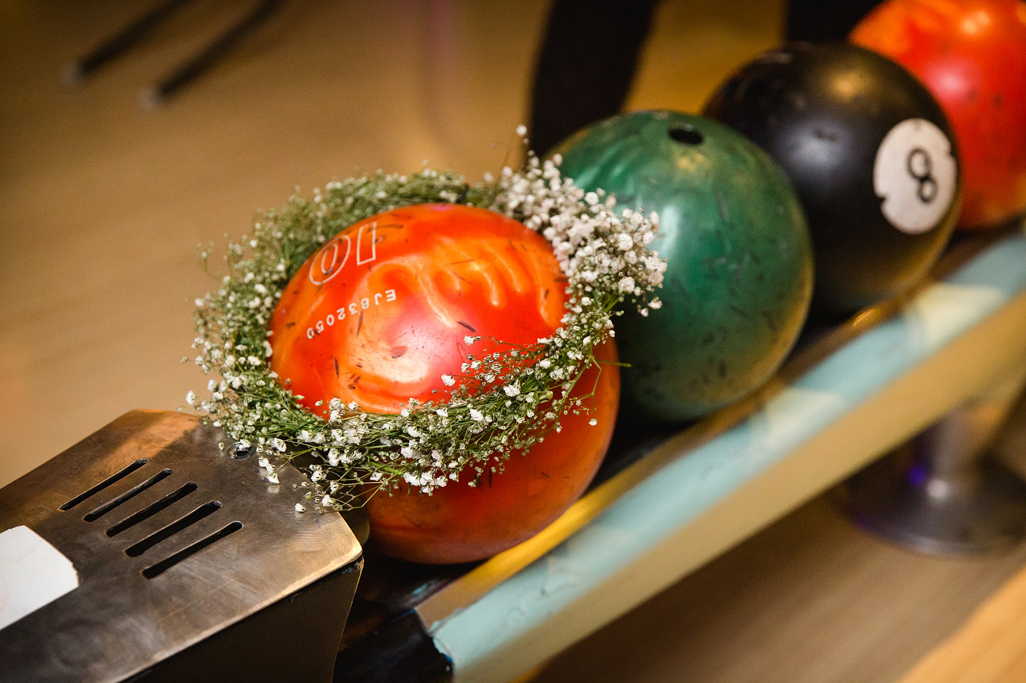 fun london wedding bowling floral crown sat on bowling ball