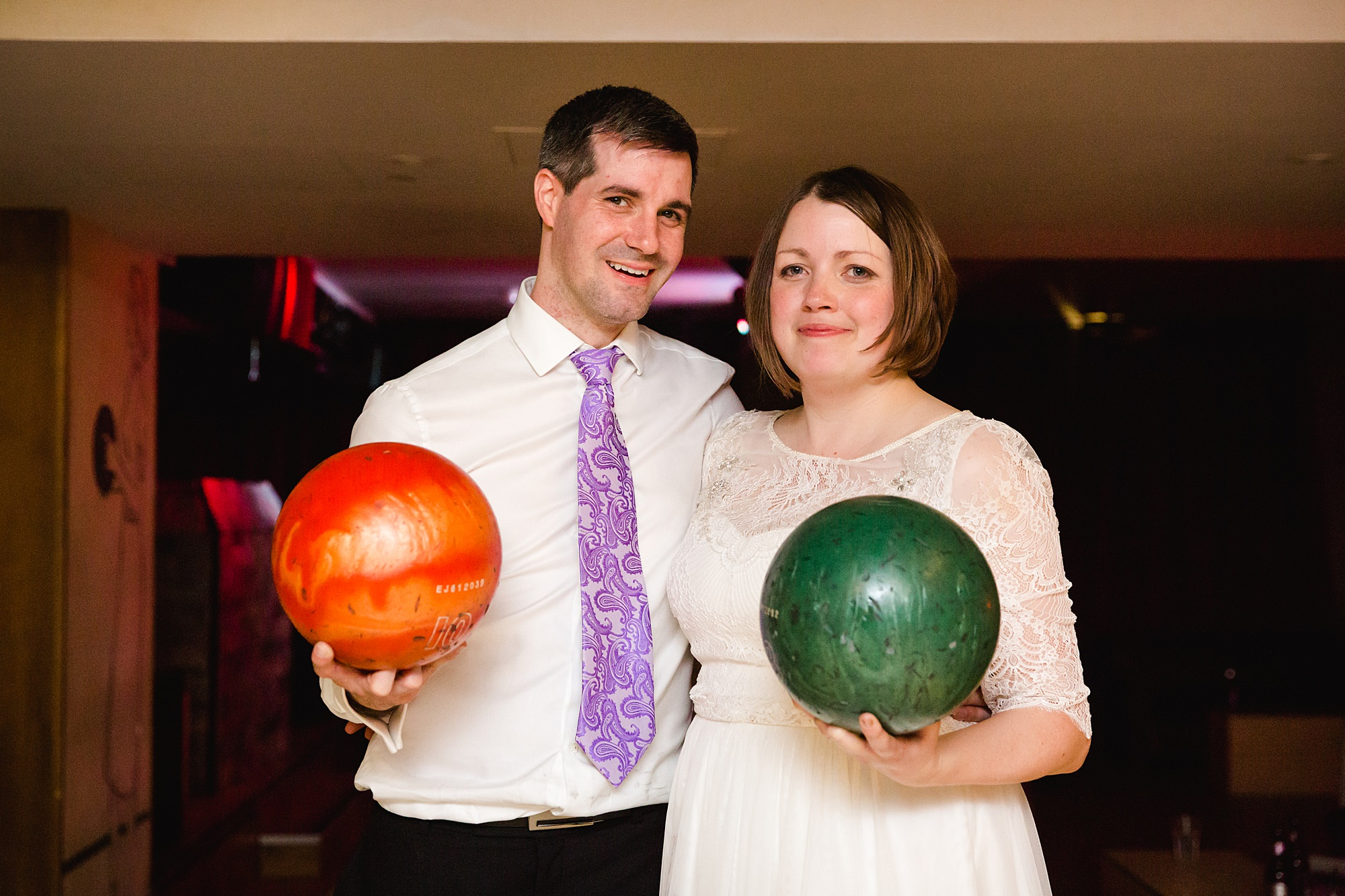 fun london wedding bowling bride and groom with bowling balls