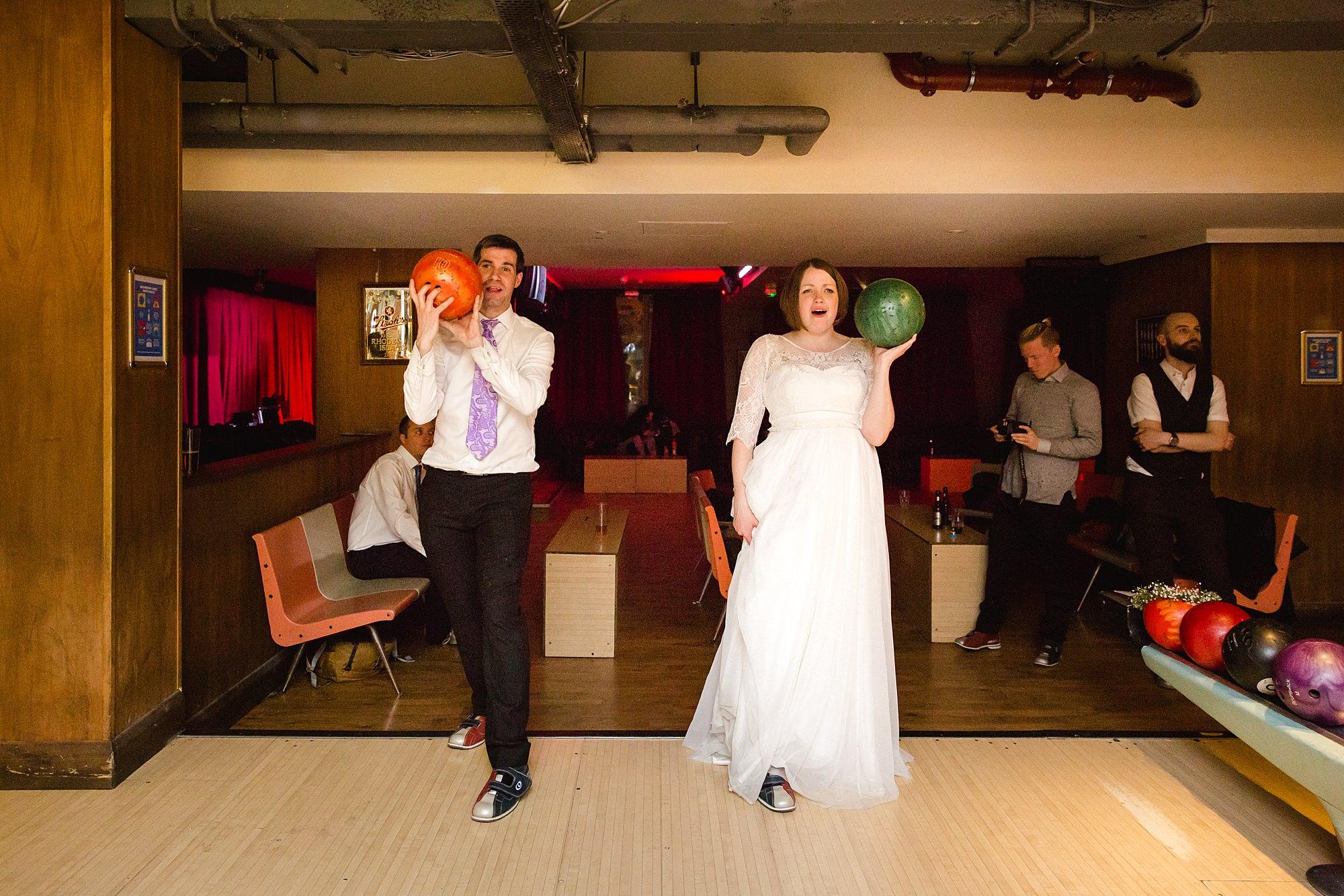 fun london wedding bowling bride and groom prepare to bowl