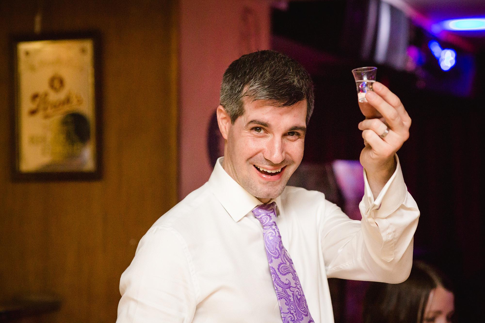 fun london wedding bowling groom with shot
