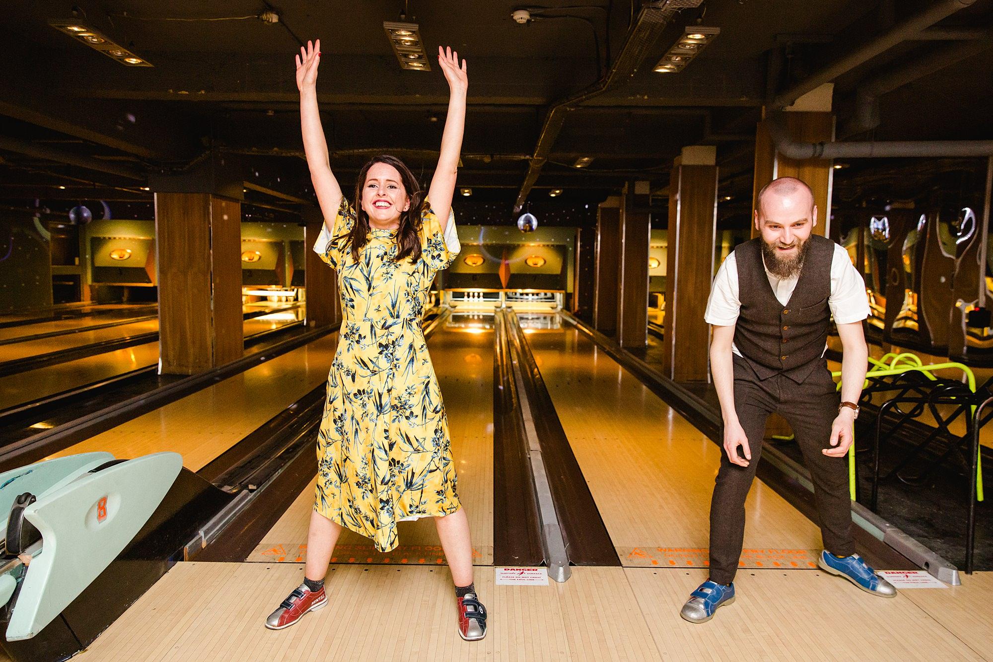 fun london wedding bowling fun guests cheering