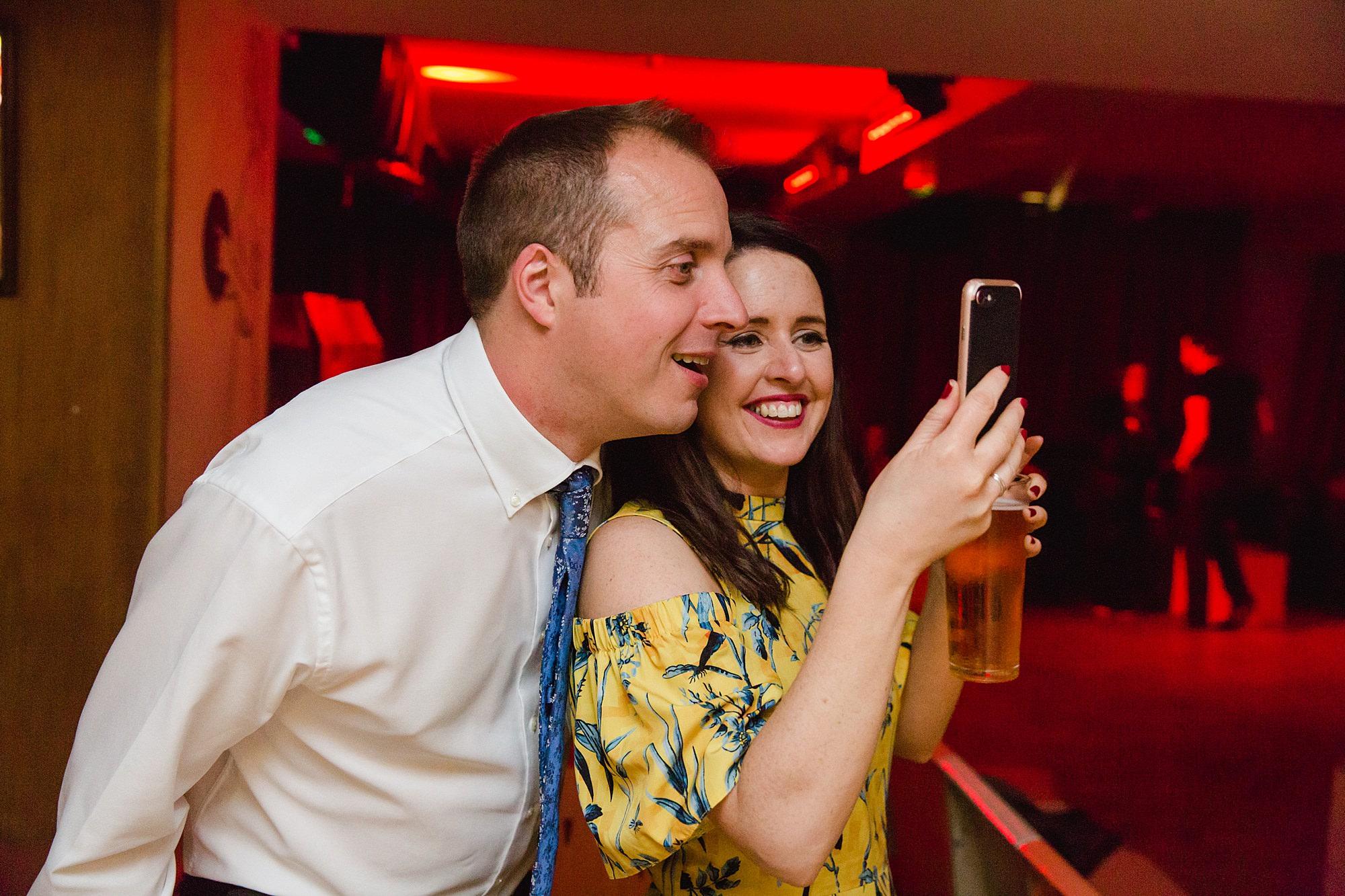 fun london wedding bowling guests taking selfie