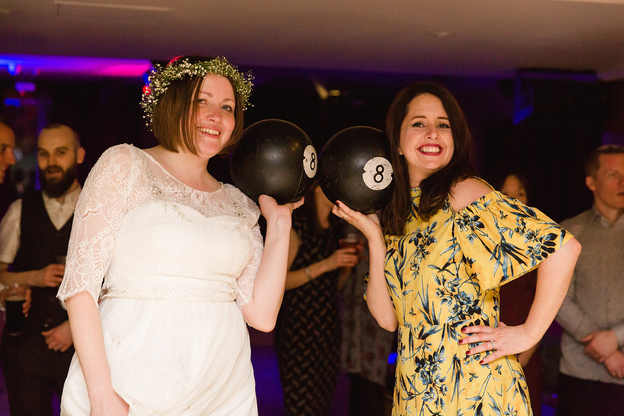 fun london wedding bowling bride and guest with bowling ball