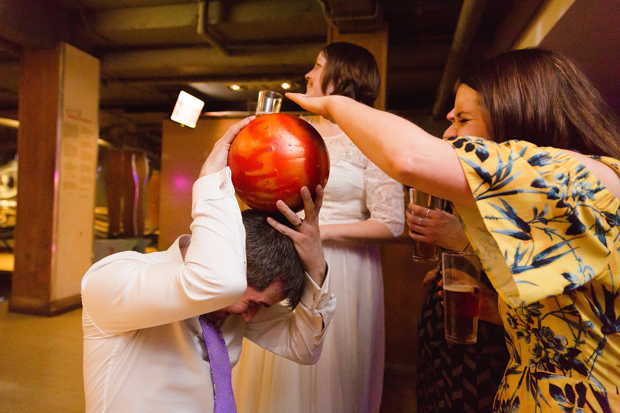 fun london wedding bowling groom and guests with bowling ball