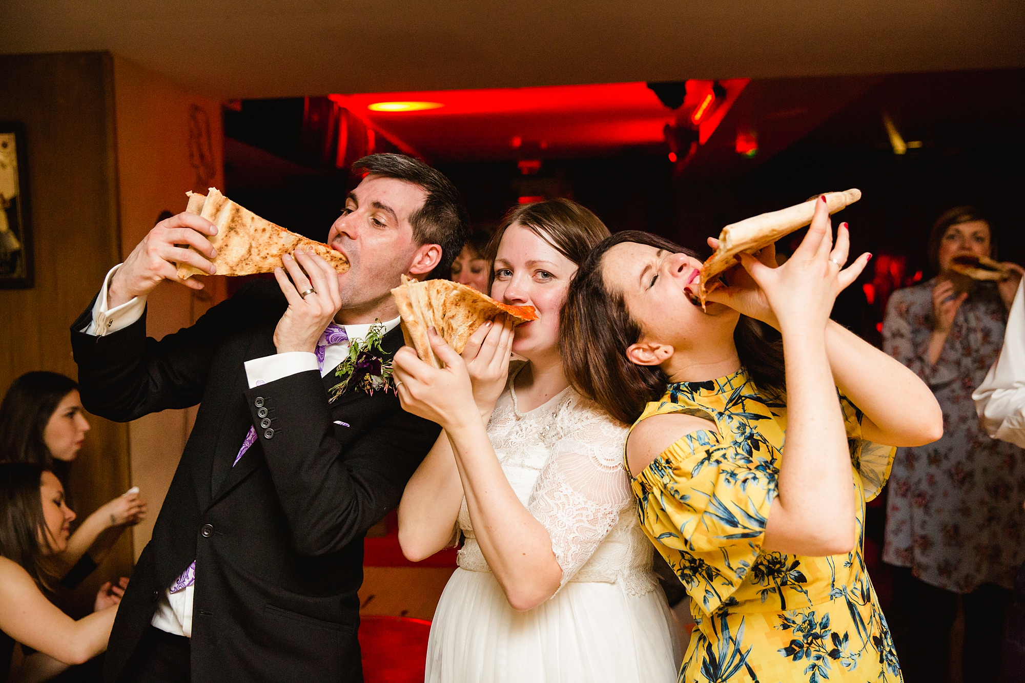 fun london wedding bowling guests eating pizza