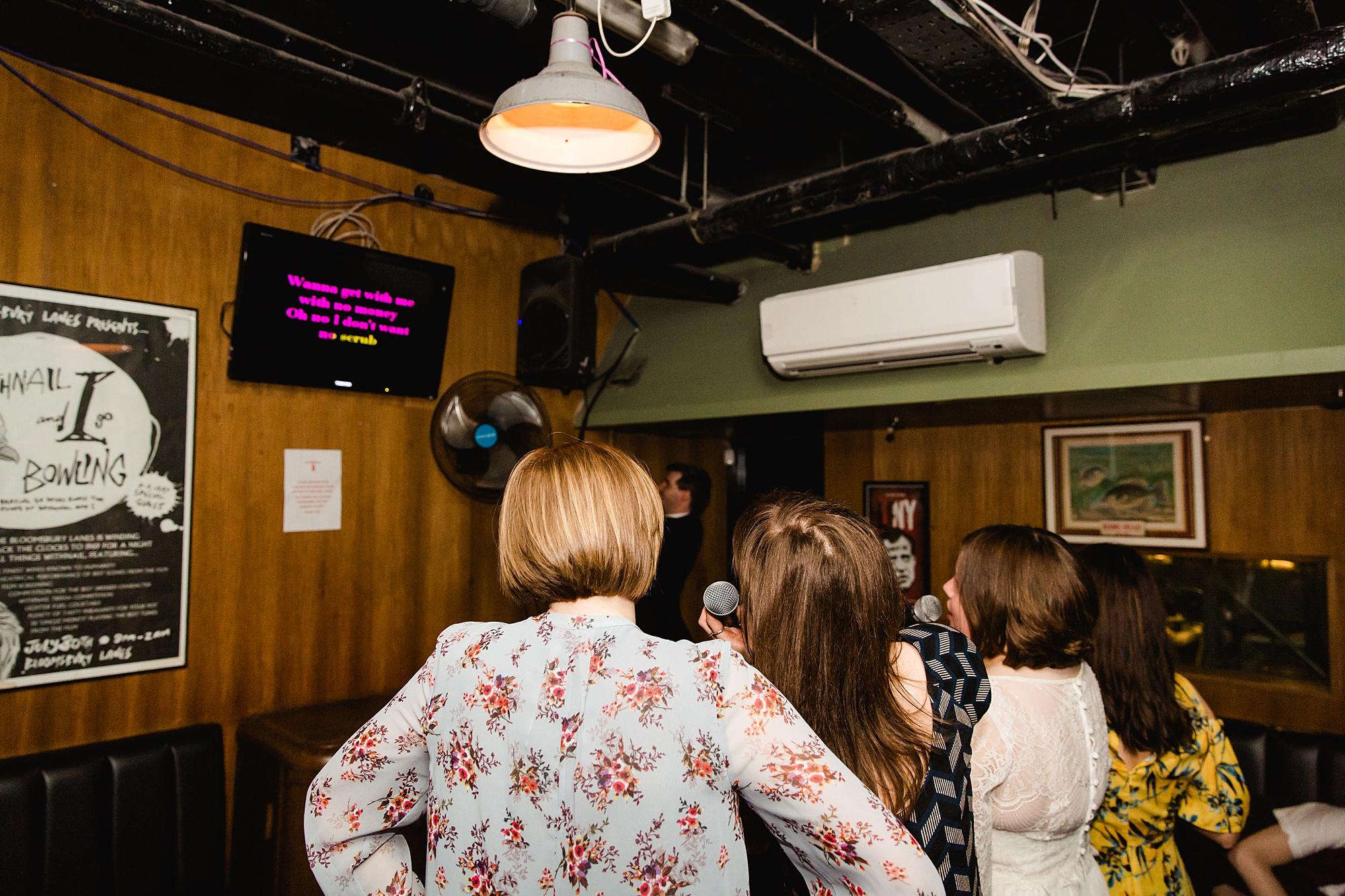 fun london wedding bowling guests enjoy karaoke