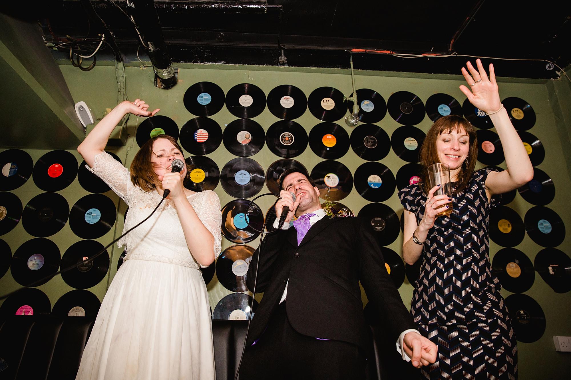 fun london wedding bowling bride and groom sing karaoke