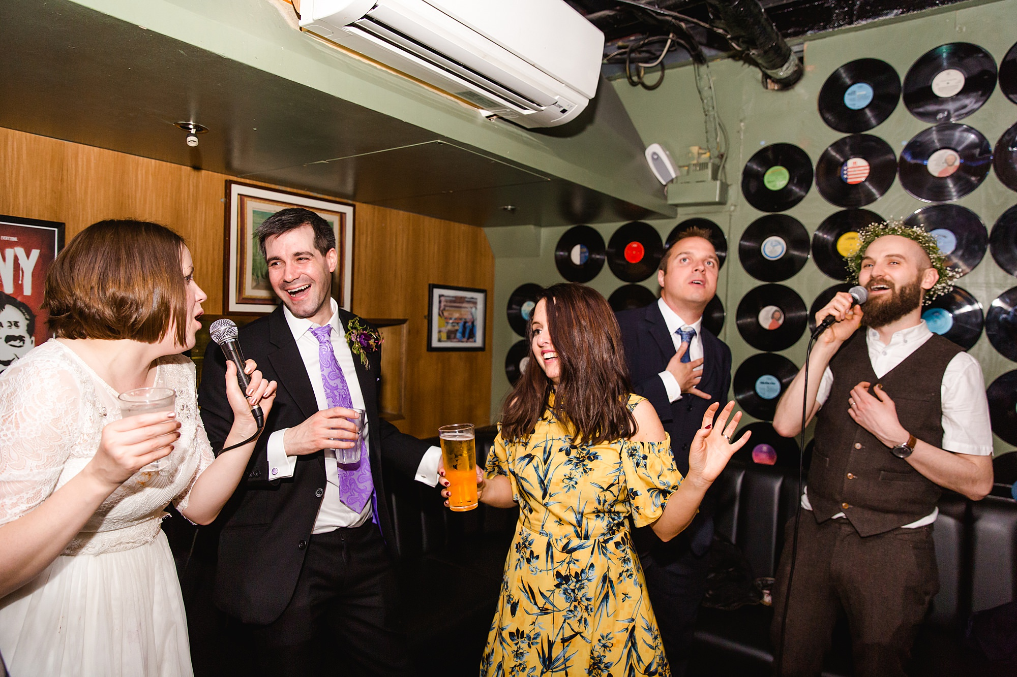 fun london wedding bowling guests singing and laughing