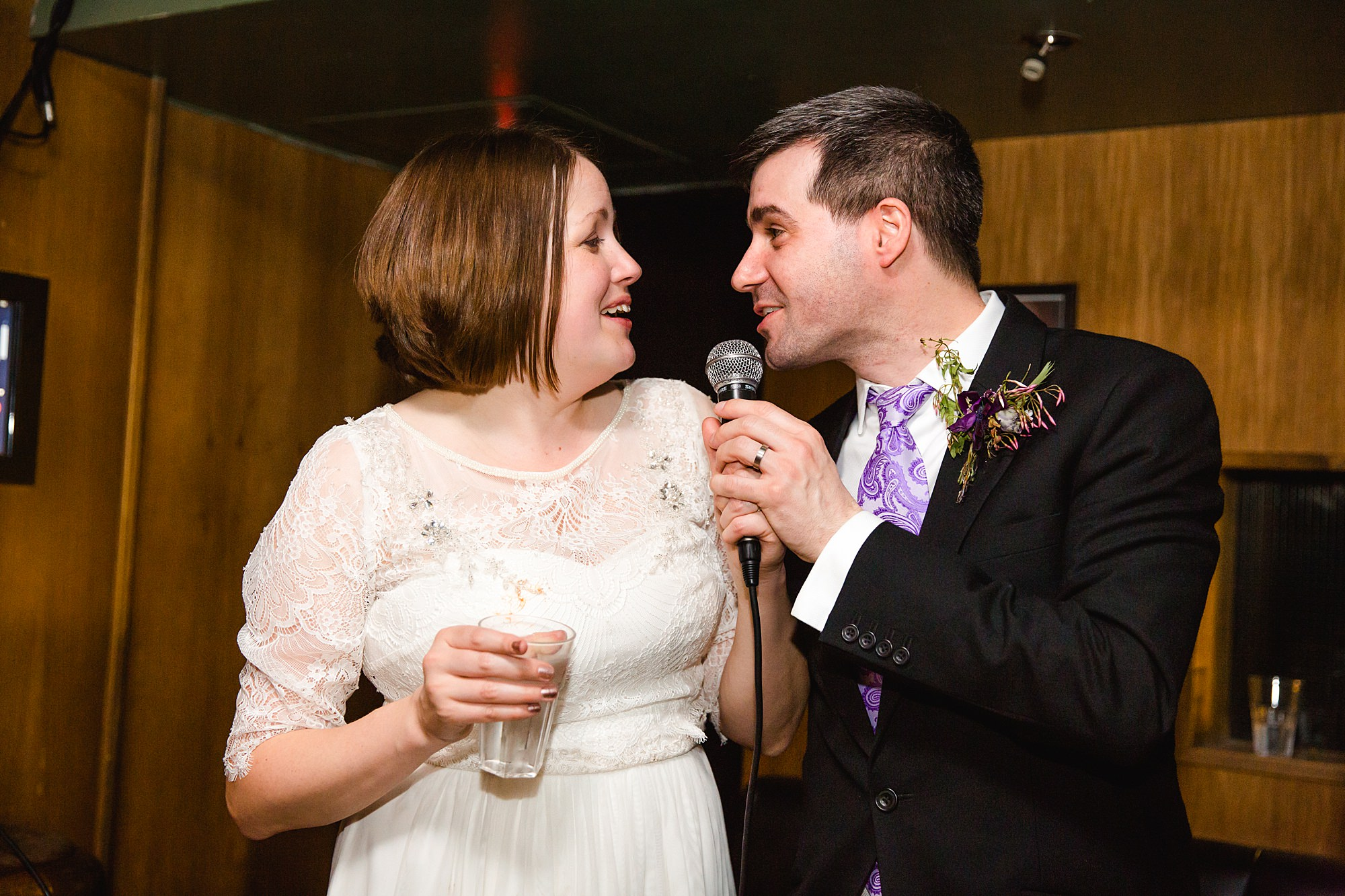 fun london wedding bowling groom and bride sing together