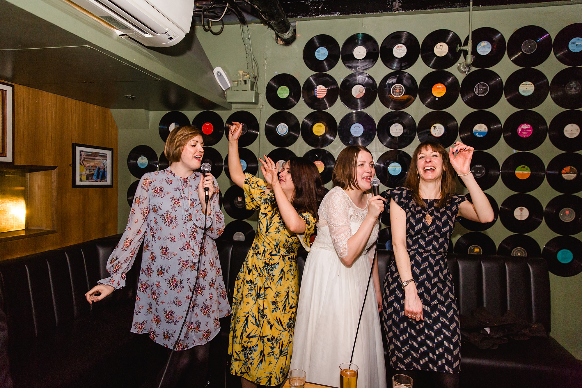 fun london wedding bowling guests singing together