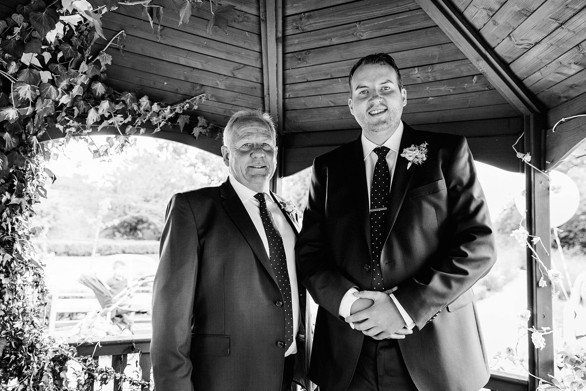 fun outdoor wedding groom and his father